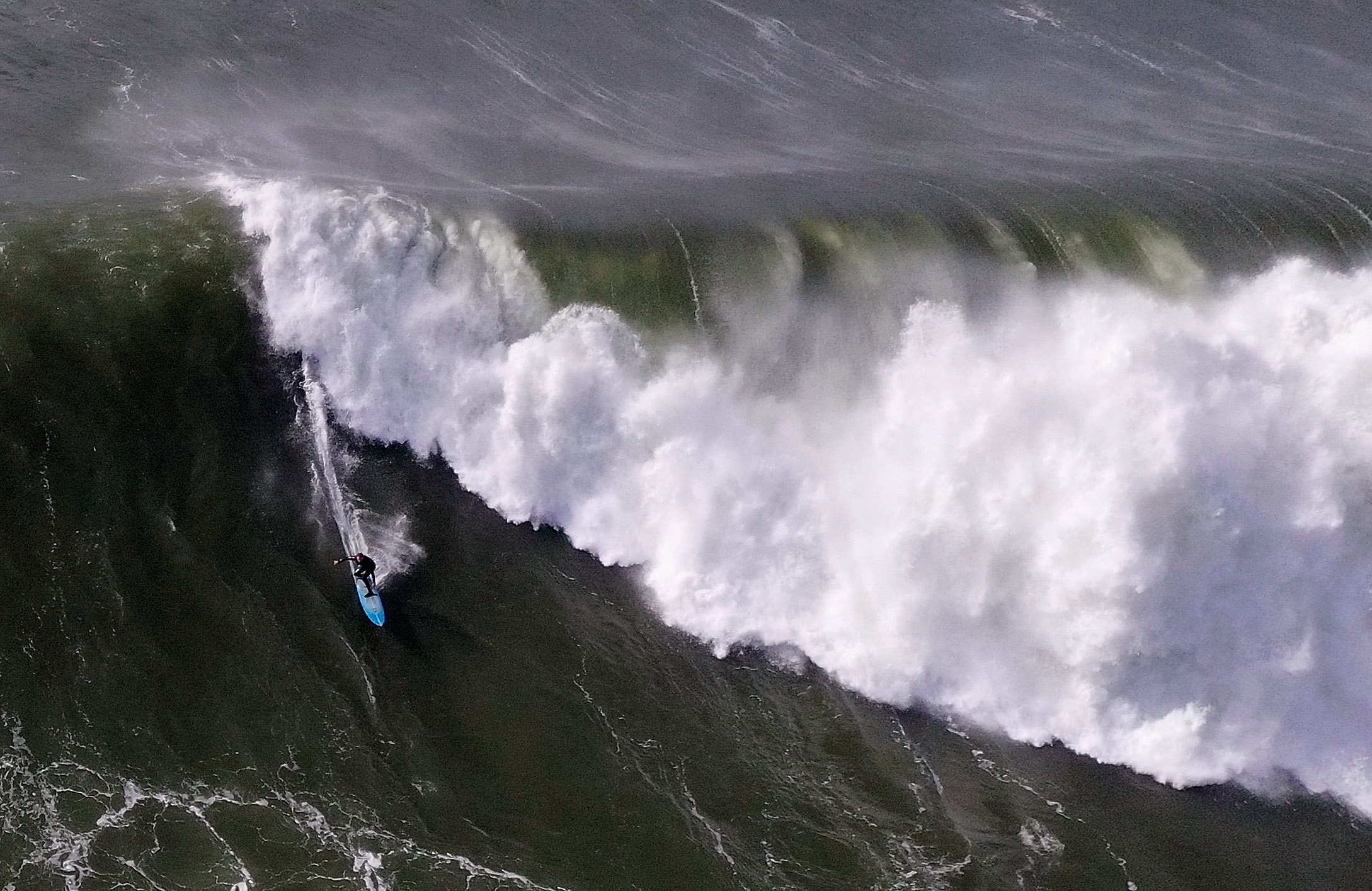 A surfer rides a giant wave at Mavericks on Dec. 17, 2018, in Half Moon Bay. (Credit: Ezra Shaw/Getty Images)