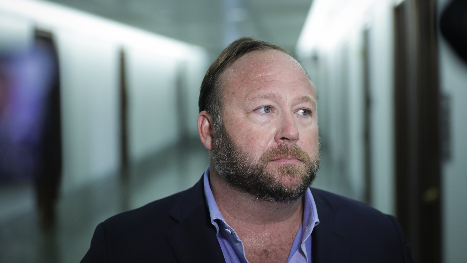 Alex Jones of InfoWars talks to reporters outside a Senate Intelligence Committee hearing concerning foreign influence operations' use of social media platforms, on Capitol Hill on Sept. 5, 2018. (Credit: Drew Angerer/Getty Images)