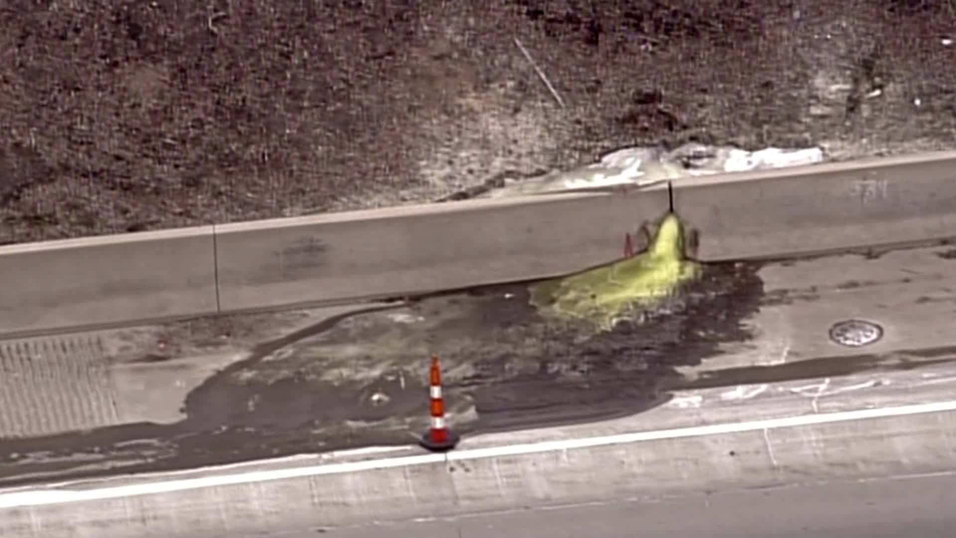 A mysterious green liquid blocked parts of Interstate 696 in Detroit on Dec. 20, 2019. (Credit: WDIV-TV via CNN)