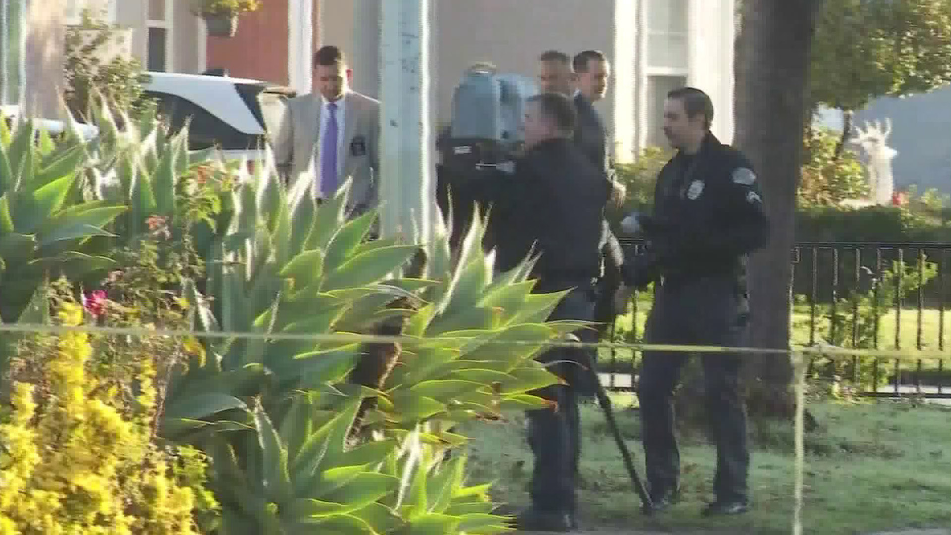 West Covina police assess the scene in the 1100 block of Larkwood Street the morning after a fatal shooting on Dec. 23, 2019. (Credit: KTLA)