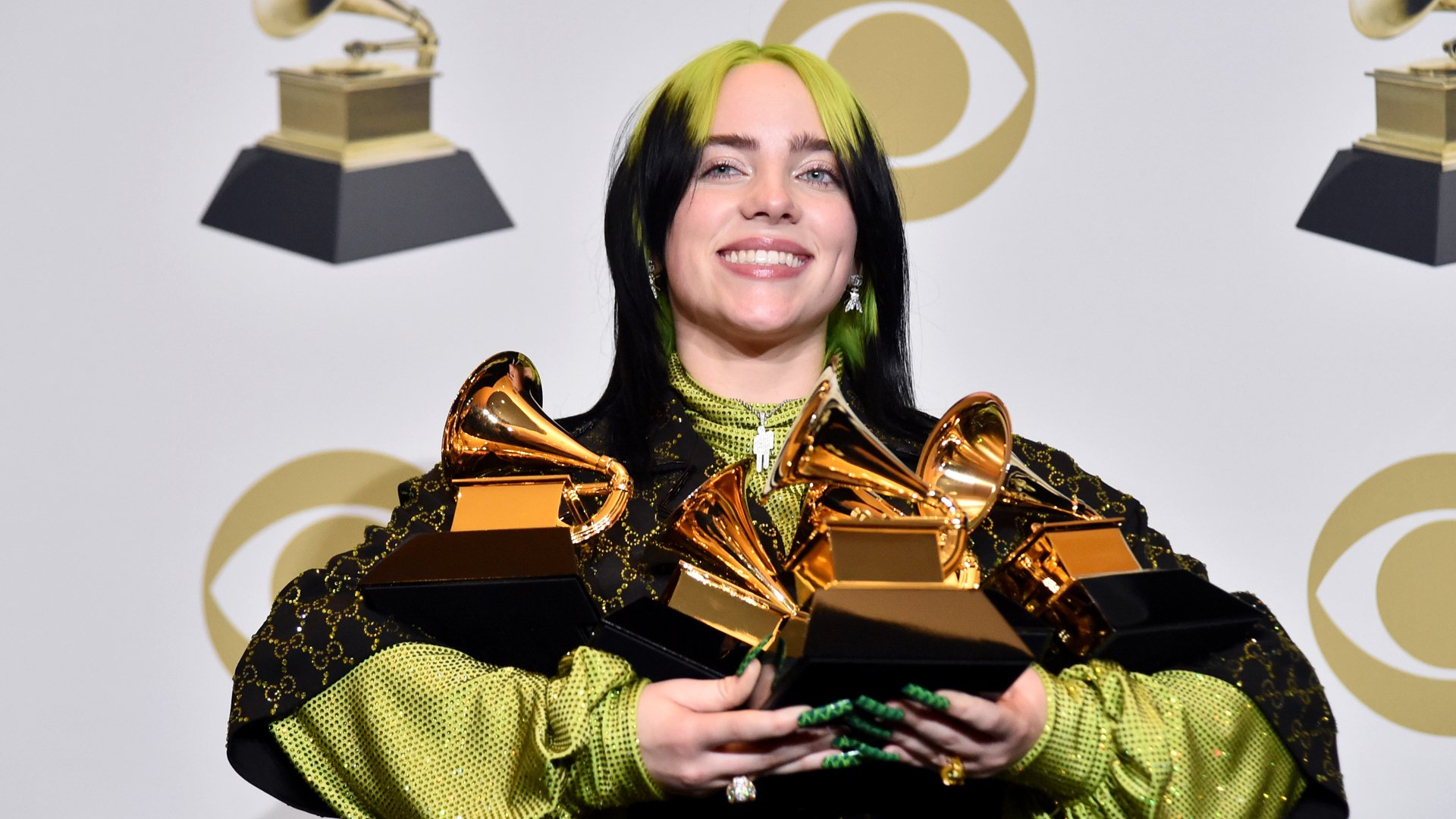 """Billie Eilish, winner of Record of the Year for """"Bad Guy"""", Album of the Year for """"when we all fall asleep, where do we go?"""", Song of the Year for """"Bad Guy"""", Best New Artist and Best Pop Vocal Album for """"when we all fall asleep, where do we go?"""", poses in the press room during the 62nd Annual GRAMMY Awards at STAPLES Center on January 26, 2020 in Los Angeles, California. (Credit: Alberto E. Rodriguez/Getty Images/The Recording Academy)"""