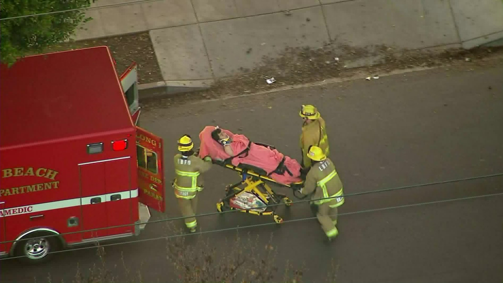 Sky5 footage shows a child being transported into an ambulance after being hit by a vehicle in Long Beach on Jan. 14, 2019.