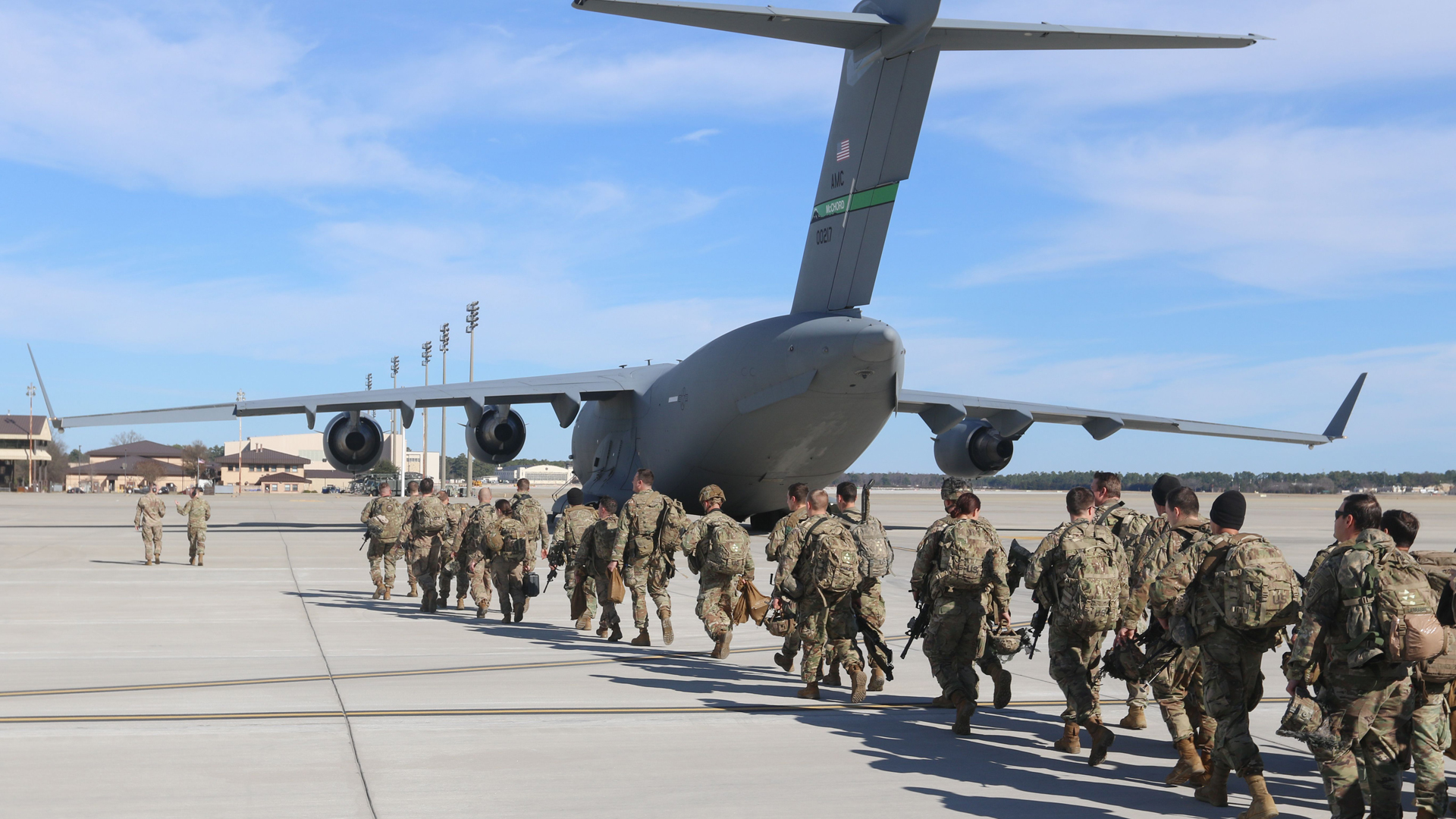 This handout picture released by the U.S. Army shows paratroopers assigned to the 2nd Battalion, 504th Parachute Infantry Regiment, 1st Brigade Combat Team, 82nd Airborne Division, deploy from Pope Army Airfield, North Carolina, on Jan. 1, 2020. (Credit: CAPT. ROBYN HAAKE/US ARMY/AFP via Getty Images)
