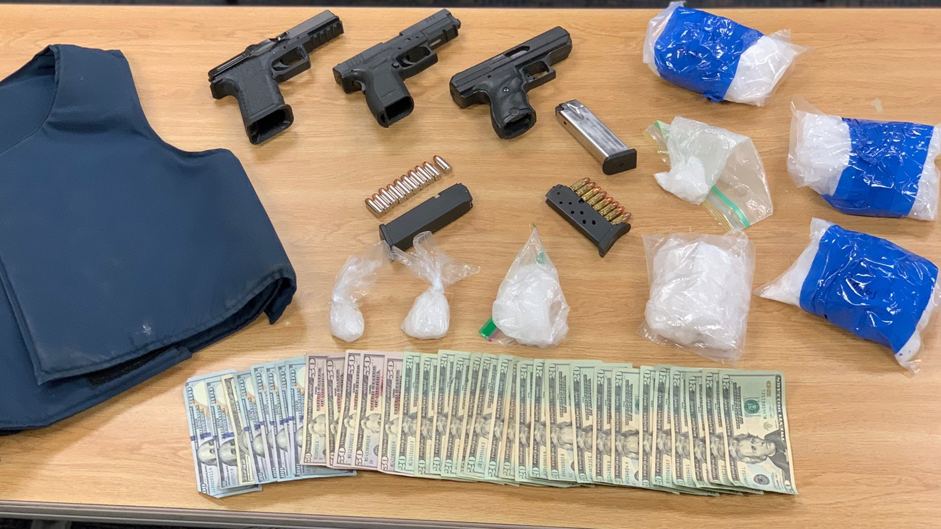 Deputies arrested two men and seized 3.7 pounds of drugs, three guns, a bullet proof vest and cash during a bust in Ventura on Jan. 9, 2020. (Credit: Ventura County Sheriff's Office)