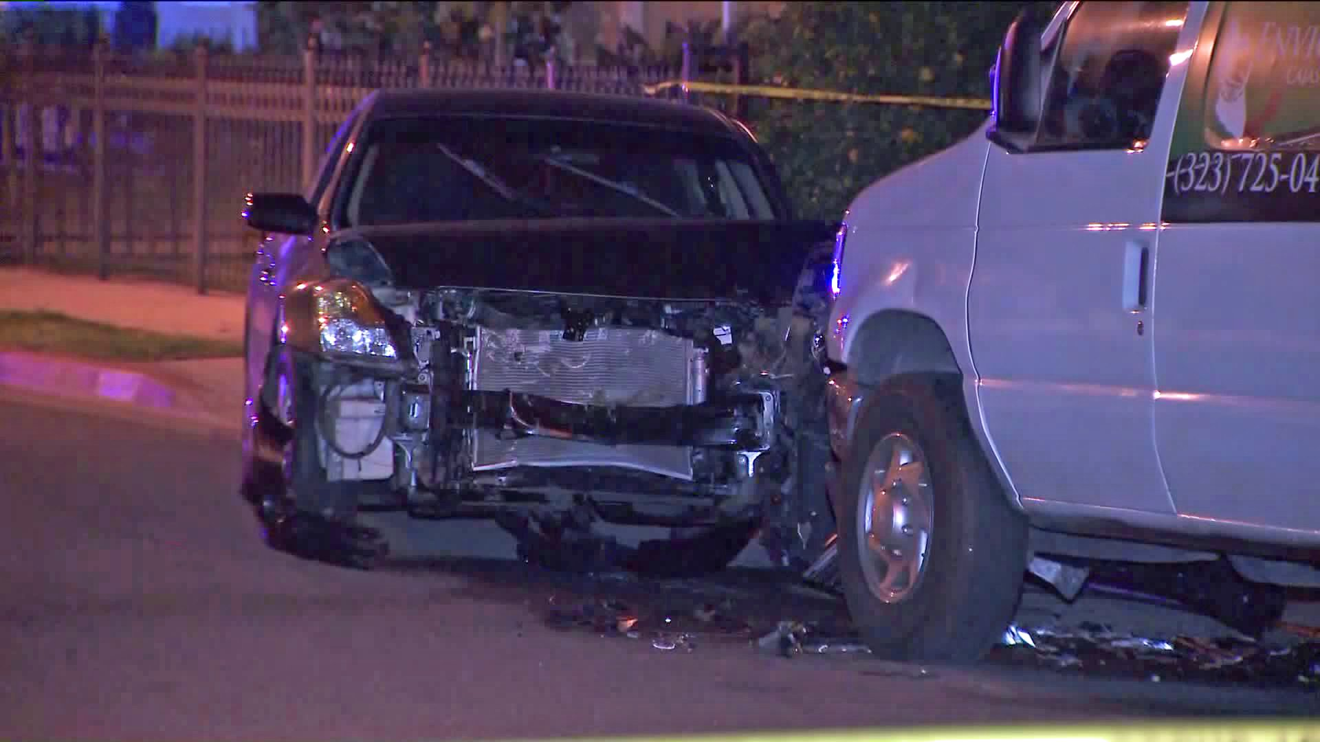 A crashed car is seen at the scene of a deadly shooting in Bell on Feb. 10, 2020. (Credit: KTLA)