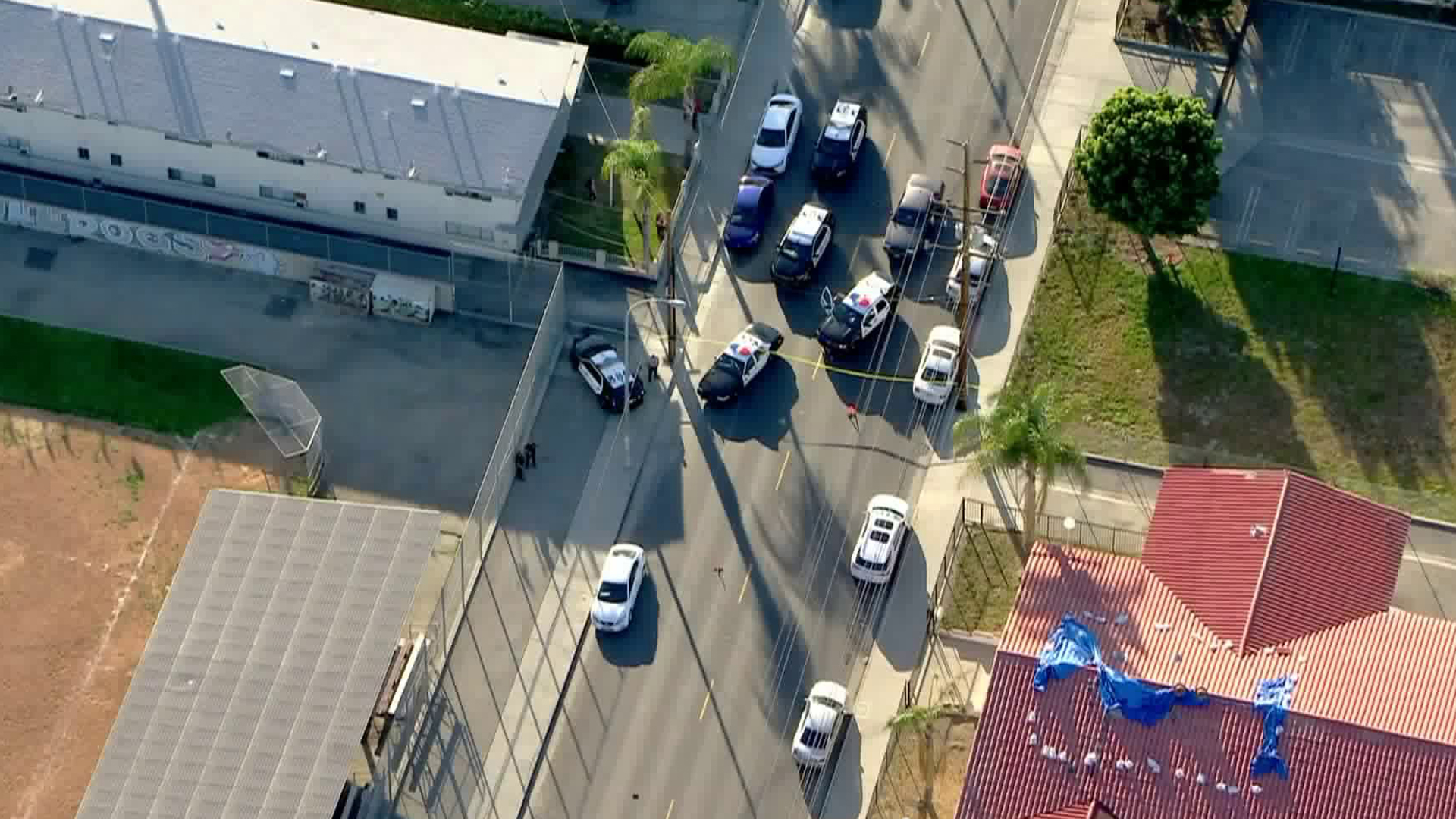 Authorities respond to a deadly shooting outside a school in Cudahy on Feb. 25, 2020. (Credit: KTLA)