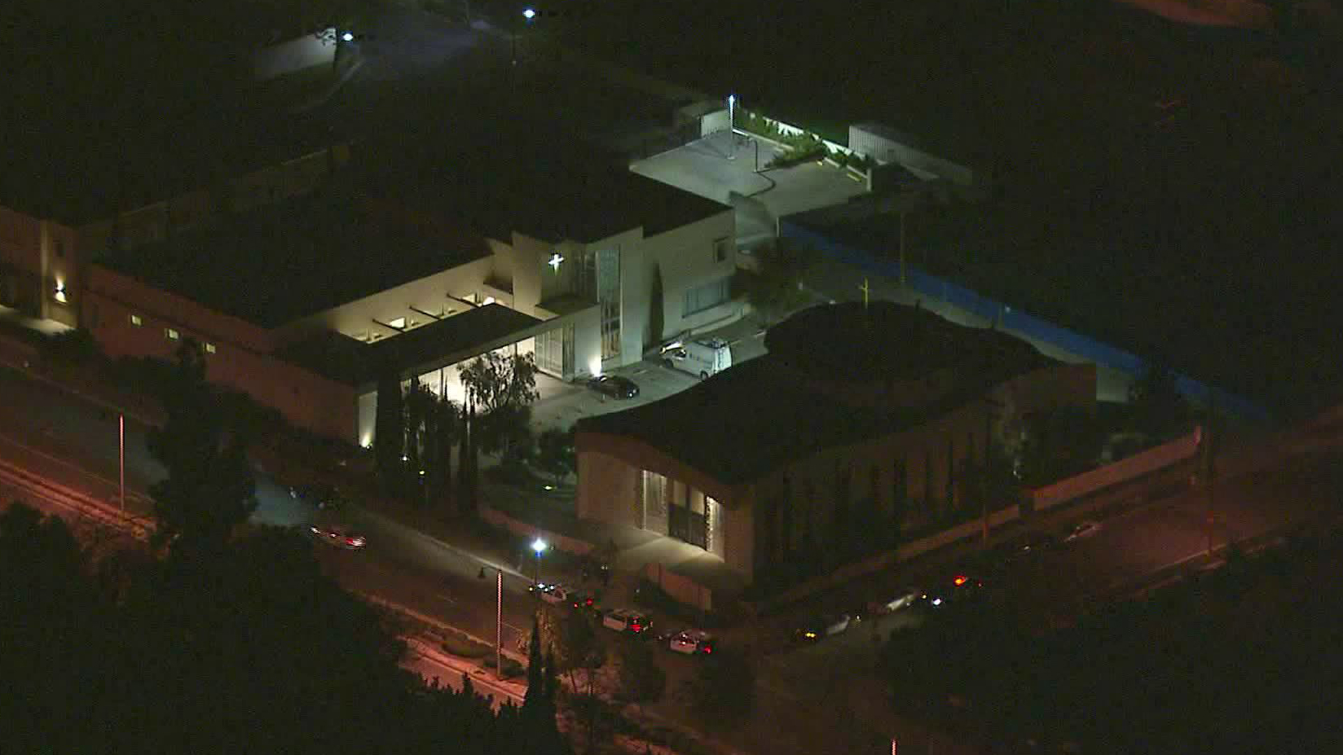 Patrol cars are stationed outside a church in East Pasadena after a vehicle carrying a corpse and casket was stolen there on Feb. 26, 2020. (Credit: KTLA)
