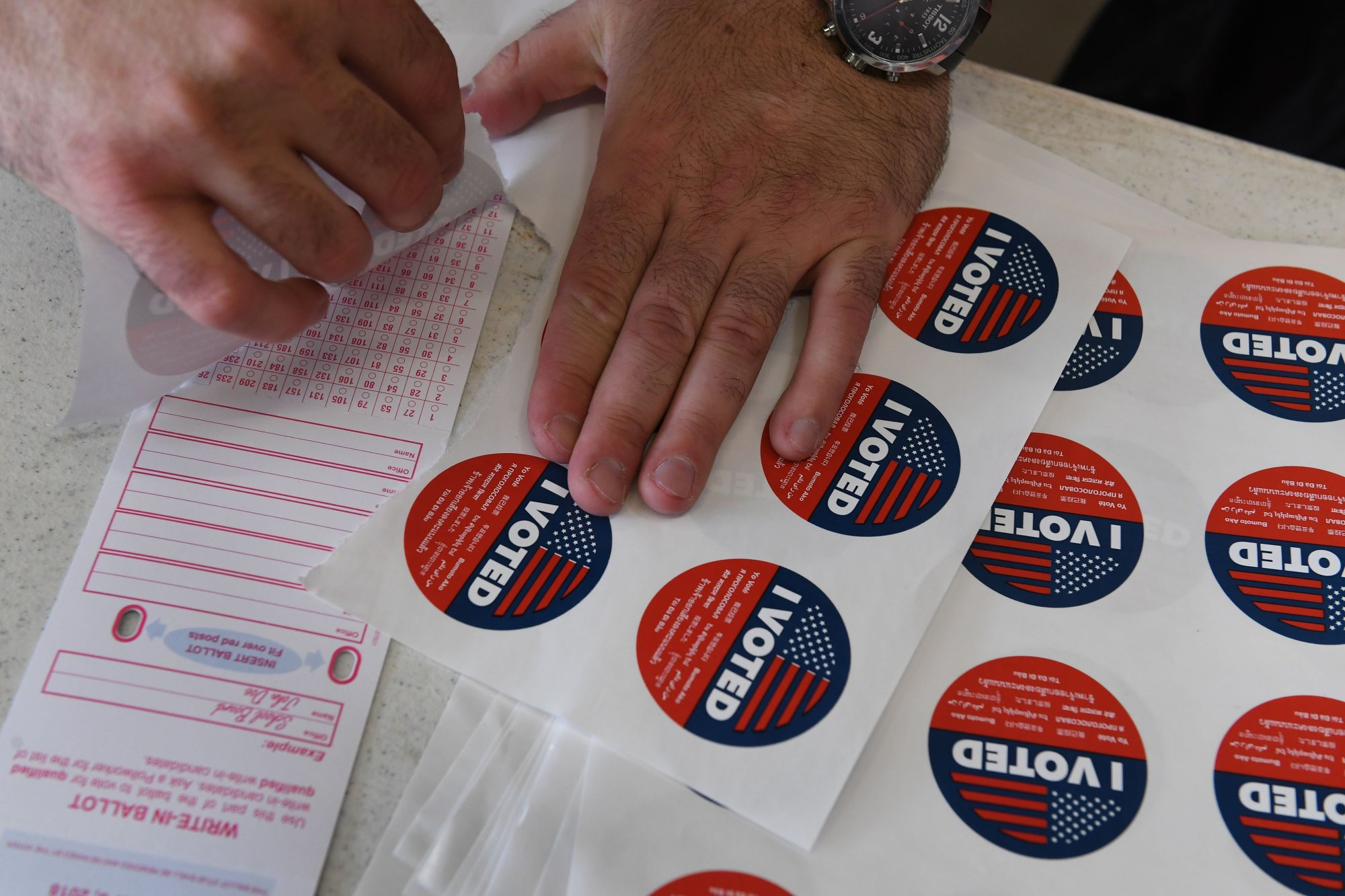 """""""I voted"""" stickers are displayed at a polling site in Venice Beach on Nov. 6, 2018. (Credit: Mark Ralston / AFP / Getty Images)"""