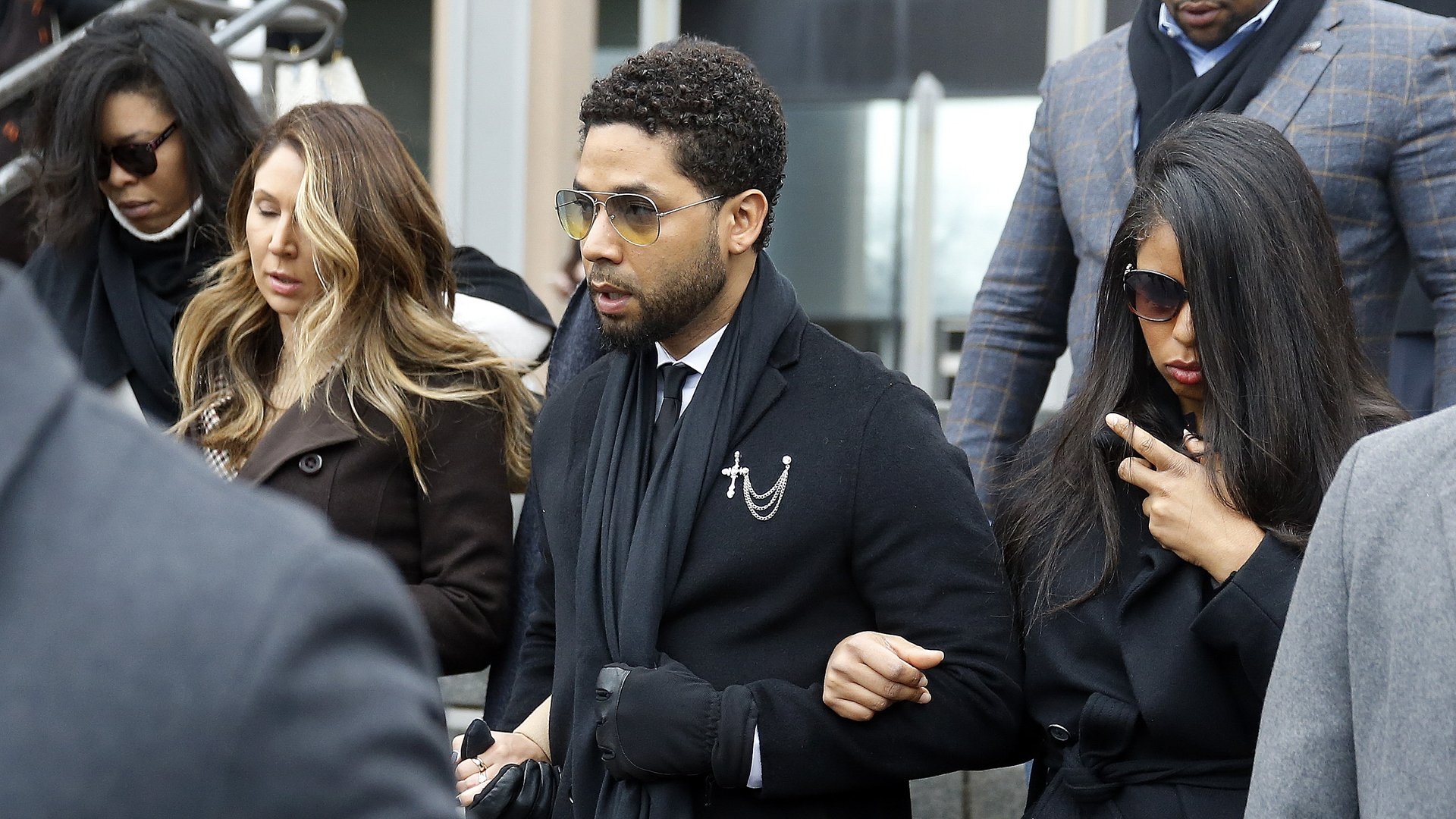 Flanked by attorneys and supporters, actor Jussie Smollett walks out of the Leighton Criminal Courthouse after pleading not guilty to a new indictment on Feb. 24, 2020 in Chicago. (Credit: Nuccio DiNuzzo/Getty Images)