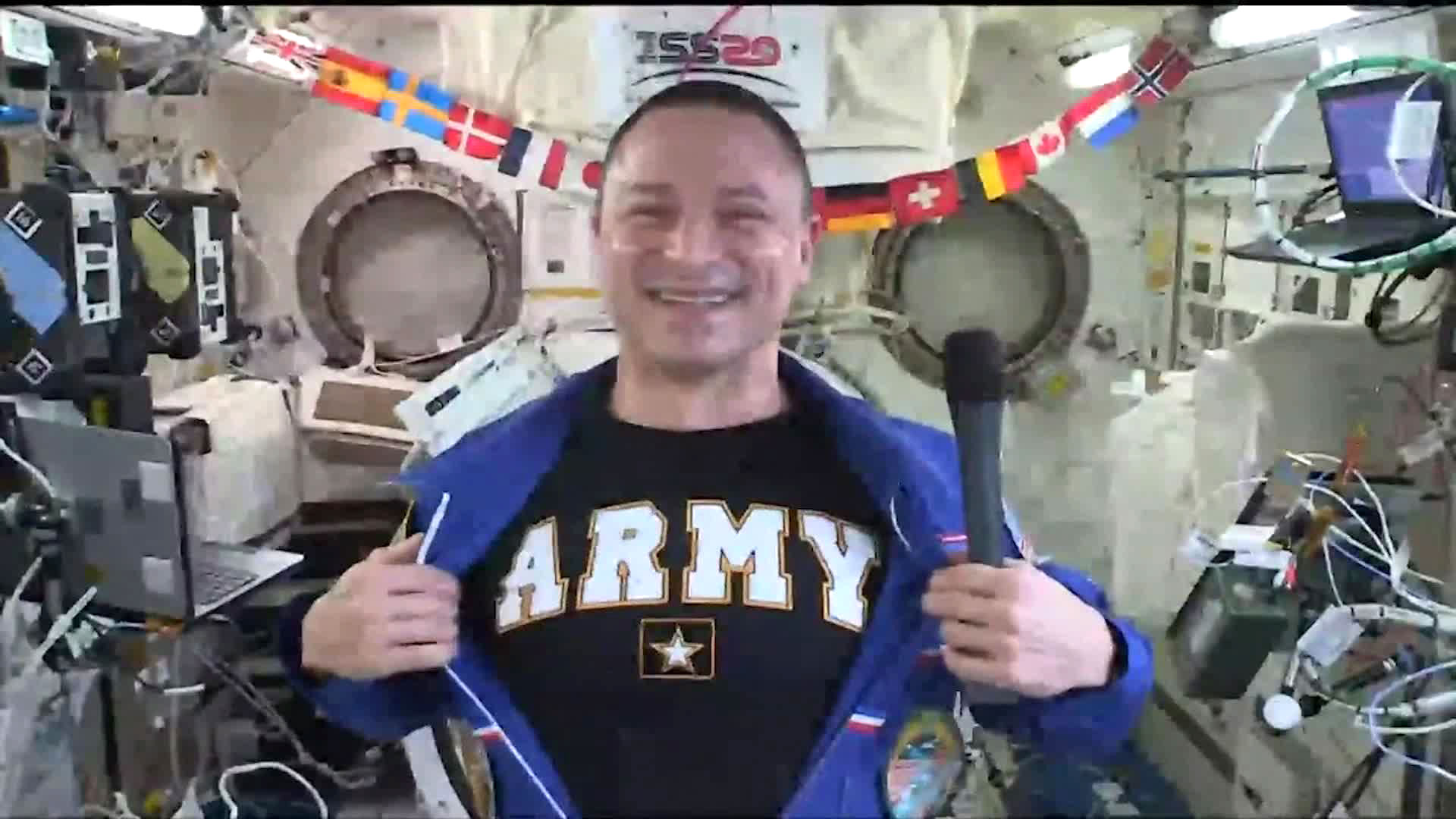 Andrew Morgan shows future recruits his Army pride underneath his space suit. (U.S. Army)