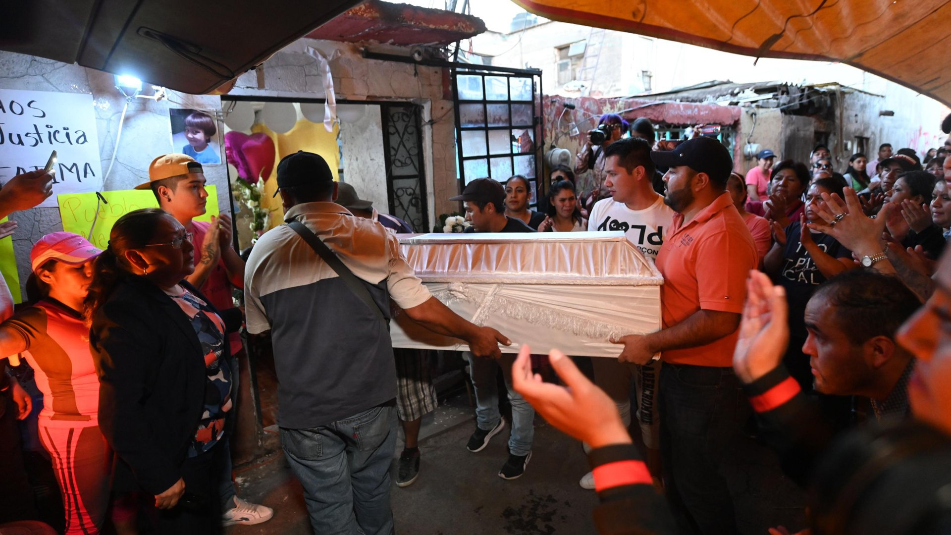 People carry the coffin during the funeral of 7-year-old Fátima, whose body was found over the weekend. (Credit: PEDRO PARDO/AFP/AFP via Getty Images)