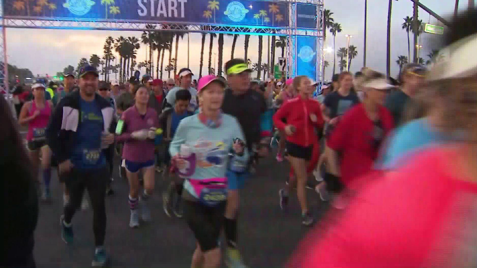 Runners race at the Surf City Marathon in Huntington Beach on Feb. 2, 2020. (Credit: KTLA)