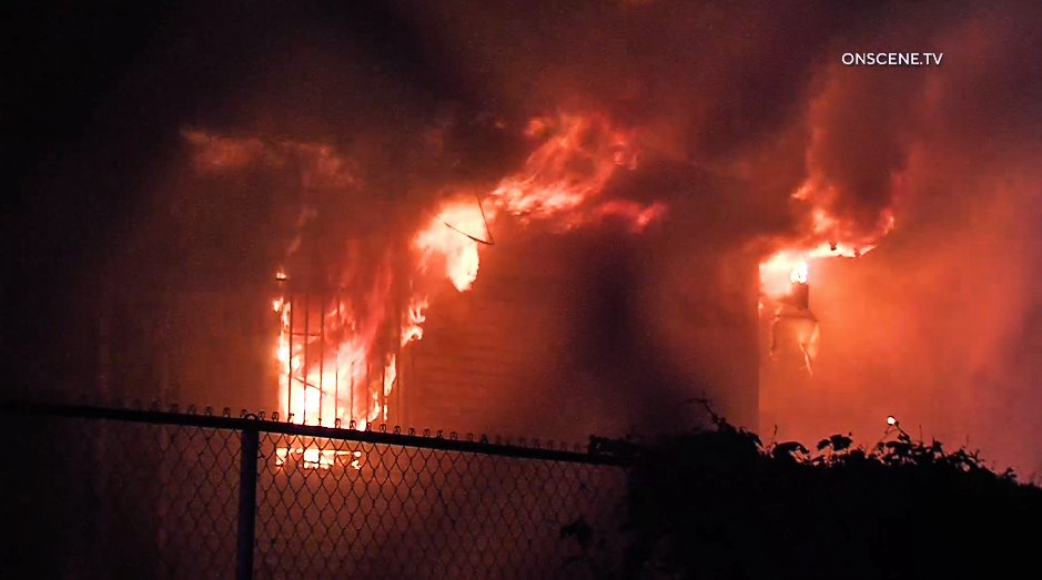 Flames tear through a home in Pomona on Feb. 5, 2020. (Credit: OnScene.TV)