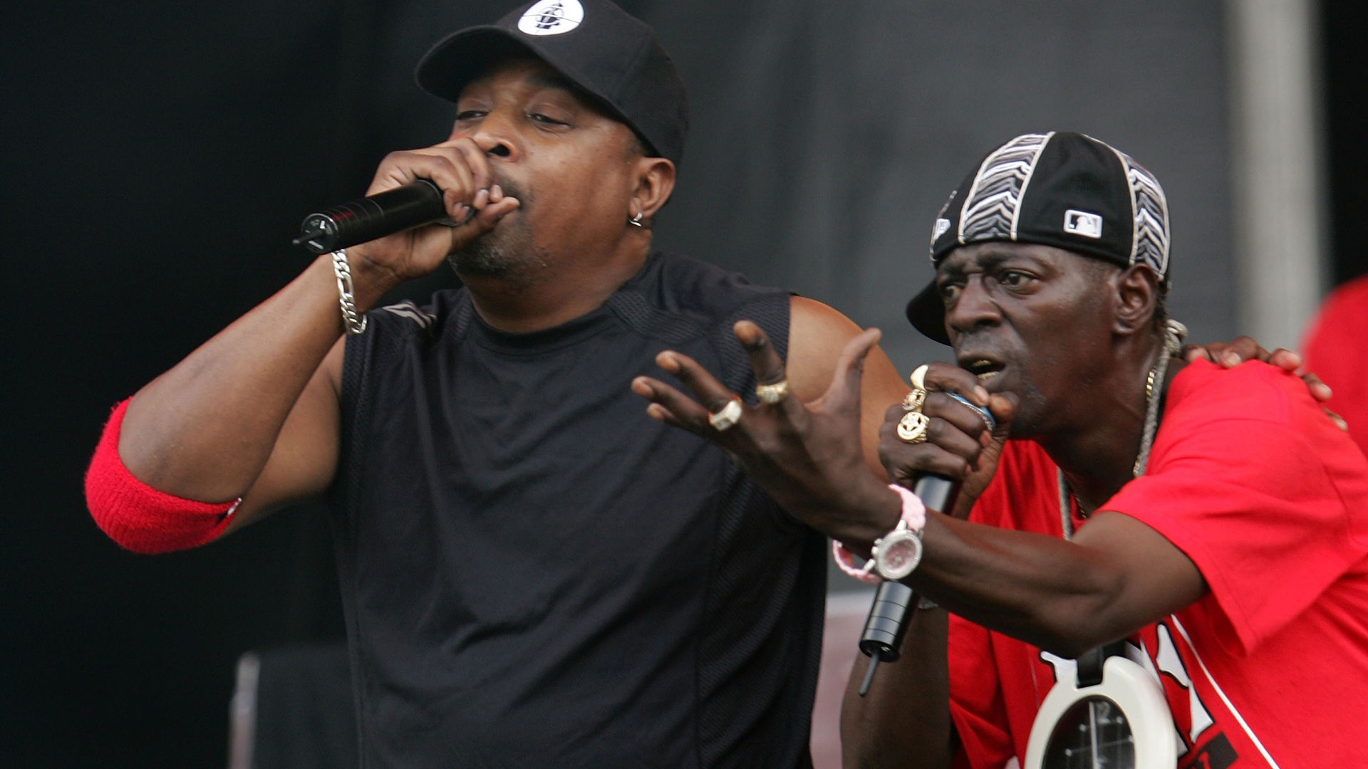 "Chuck D and Flava flav of the group Public Enemy performs on stage at the ""Rock The Bells"" tour on Randall's Island on July 28, 2007, in New York City. (Bryan Bedder/Getty Images)"