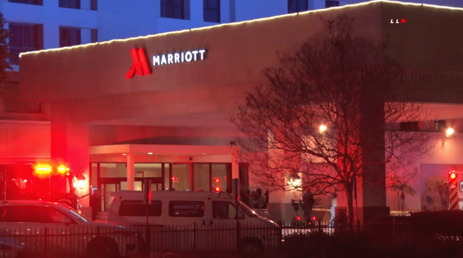 An ambulance is seen outside the the Marriott Riverside at the Convention Center, where a deadly shooting occurred on Feb. 14, 2020. (Credit: Loudlabs)