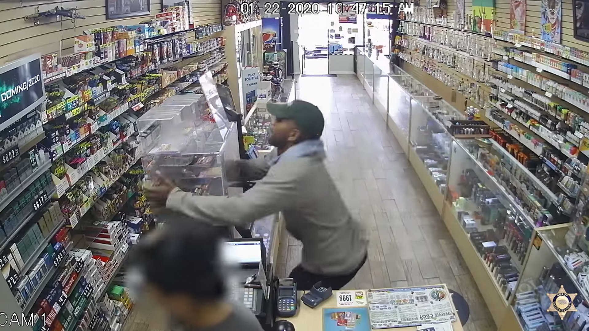 Authorities are still searching for a man who stole two lottery ticket displays in the San Dimas area in January. (Credit: Los Angeles County Sheriff's Department)