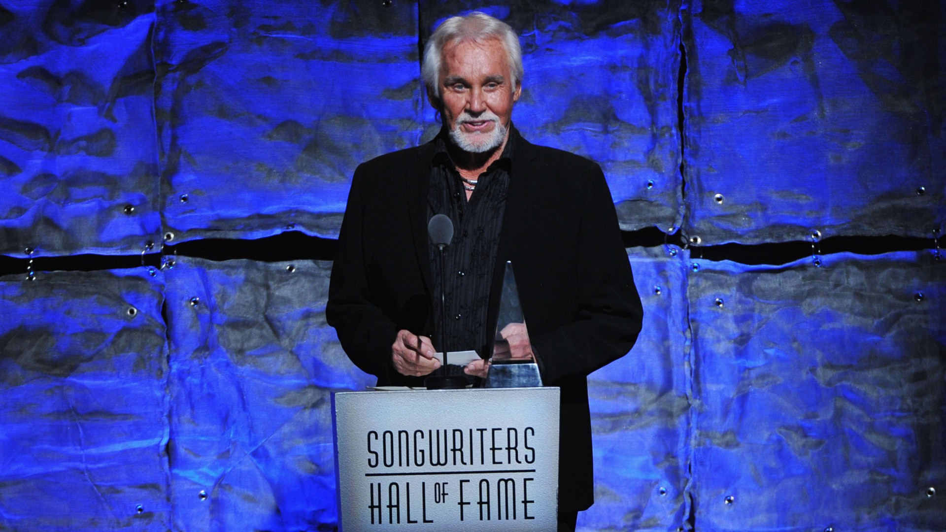 Kenny Rogers speaks onstage at the Songwriters Hall of Fame 43rd Annual induction and awards at The New York Marriott Marquis on June 14, 2012 in New York City. (Theo Wargo/Getty Images for Songwriters Hall Of Fame)