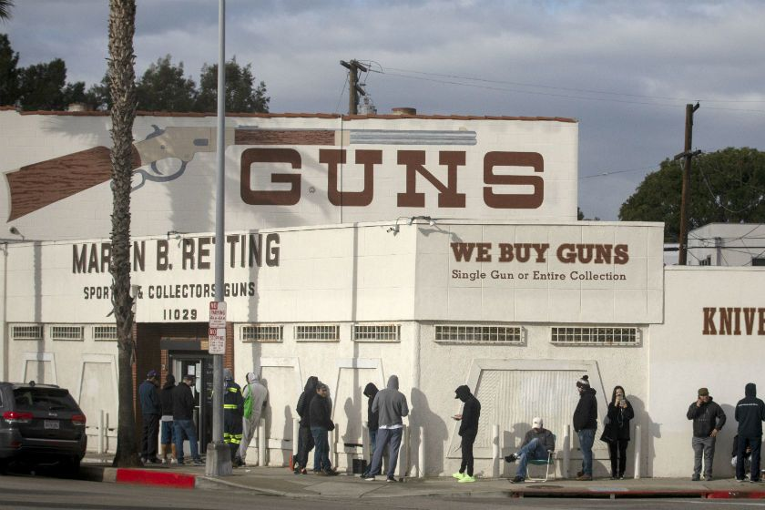 A line at the Martin B. Retting gun store in Culver City extends out the door and around the corner on March 22, 2020. (Francine Orr / Los Angeles Times)
