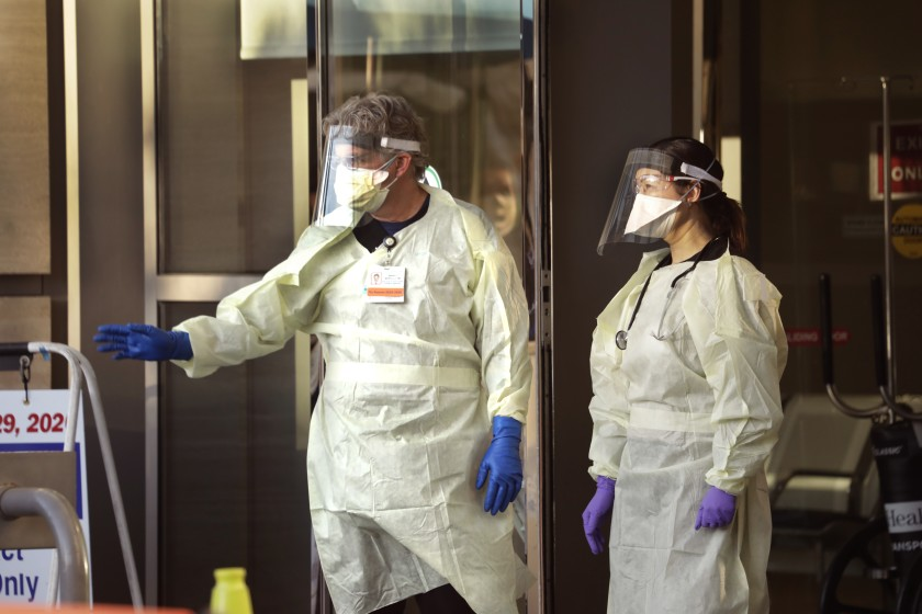 COVID-19 patients are beginning to flow into local hospitals. Above, medical staffers at UCLA.(Carolyn Cole / Los Angeles Times)