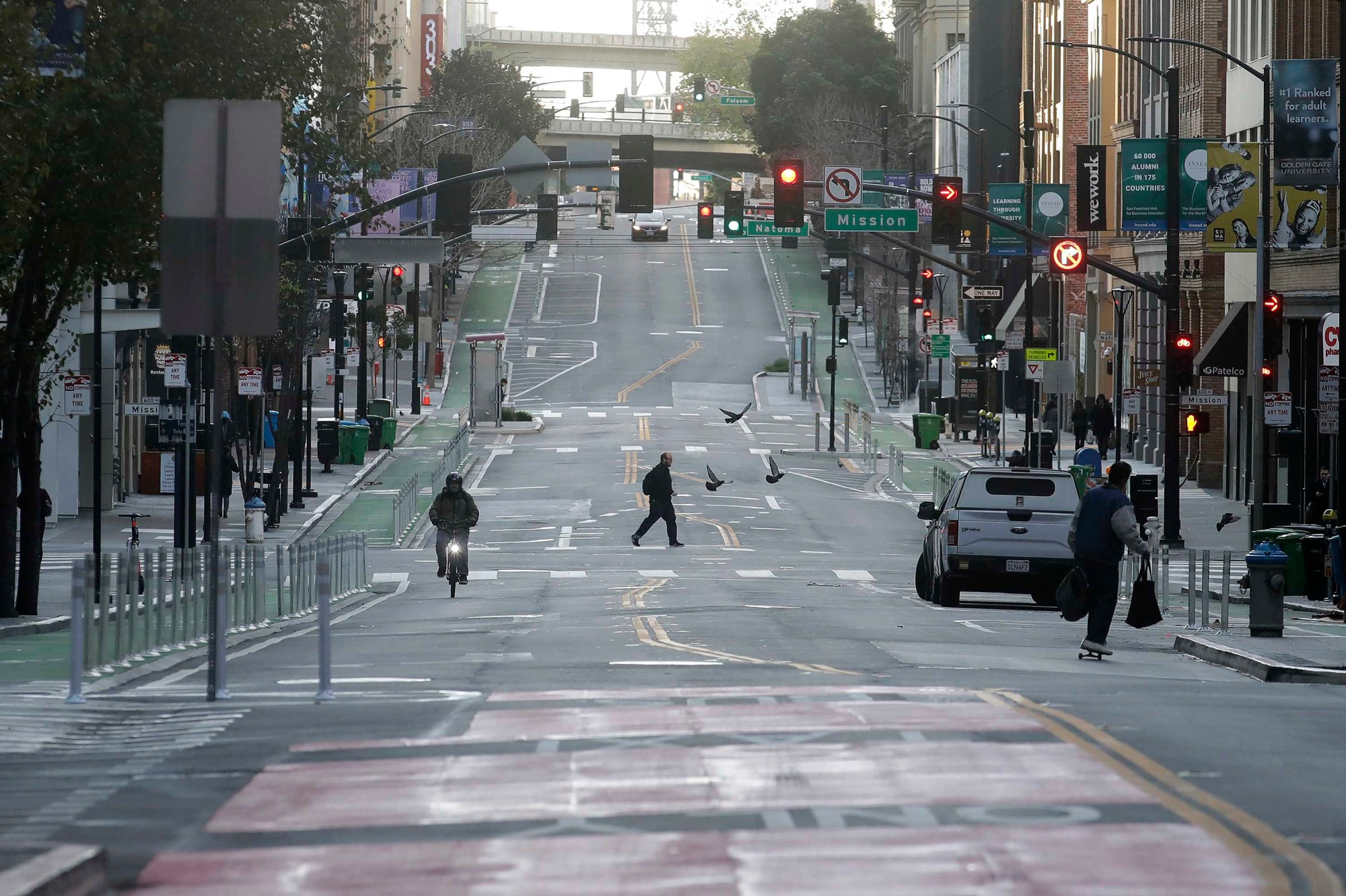 A man crosses a nearly empty street in San Francisco, Tuesday, March 17, 2020. (Jeff Chiu/AP)