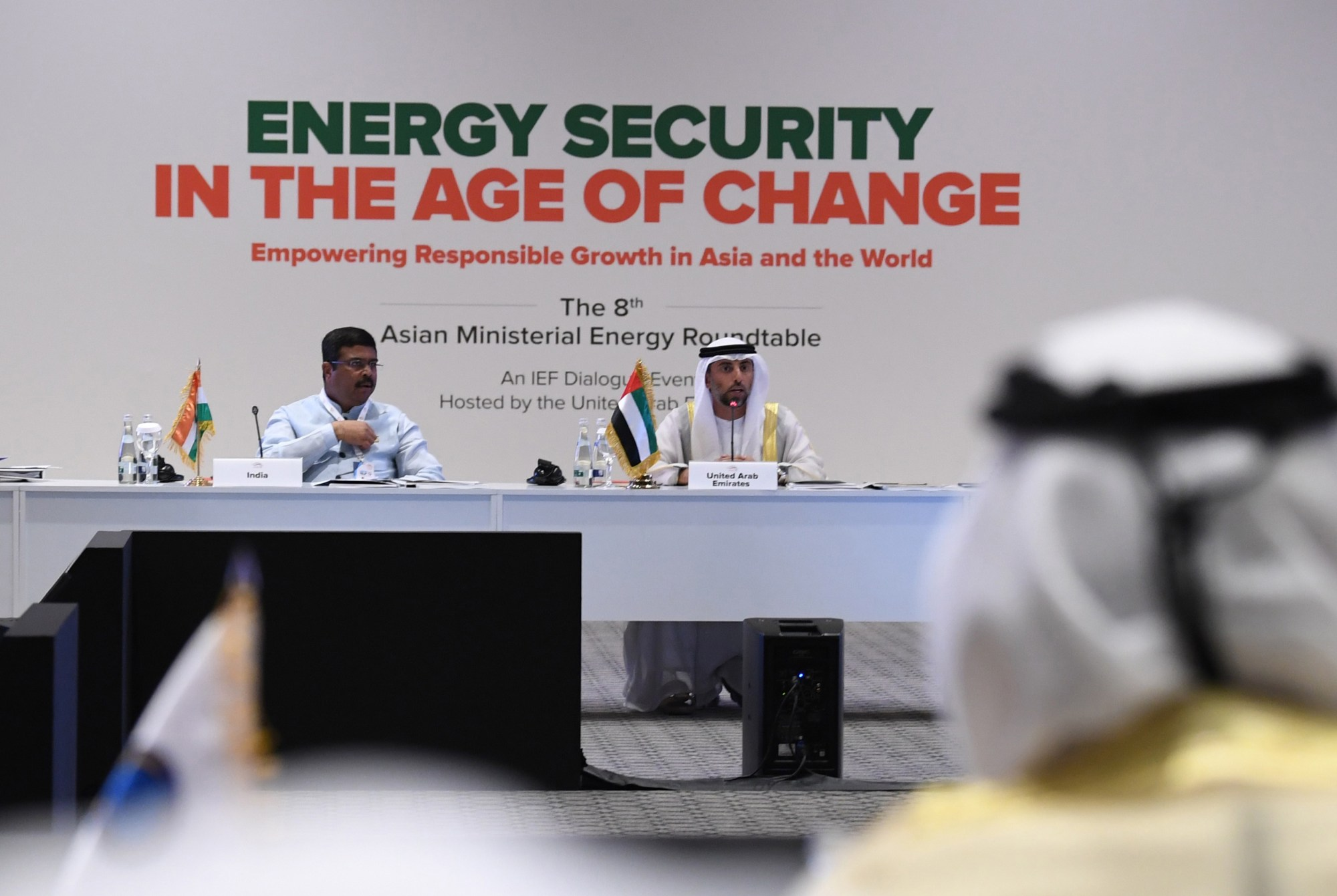 Indian Oil Minister Dharmendra Pradhan (L) listens as the United Arab Emirates' Energy Minister Suheil al-Mazrouei (C ) addreses the 24th World Energy Congress (WEC) in the Emirati capital Abu Dhabi on September 10, 2019. The OPEC petroleum exporters' cartel and key independent producers are deliberating how to halt a slide in prices that has persisted despite previous cuts and US sanctions that have squeezed supply from Iran and Venezuela. (KARIM SAHIB/AFP via Getty Images)