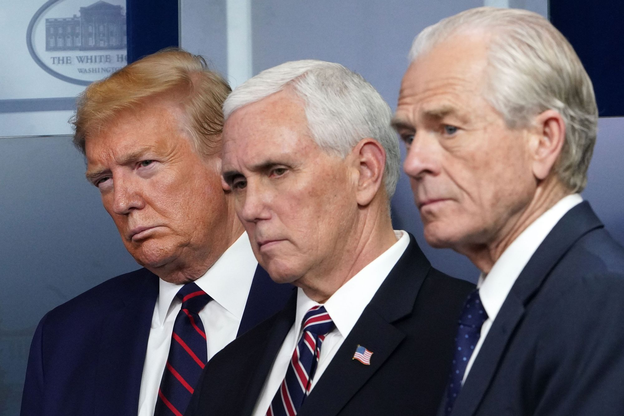 President Donald Trump, Vice President Mike Pence and Director of Trade and Manufacturing Policy Peter Navarro look on during the White House's daily briefing on the novel coronavirus on April 2, 2020. (Credit: MANDEL NGAN / AFP / Getty Images)