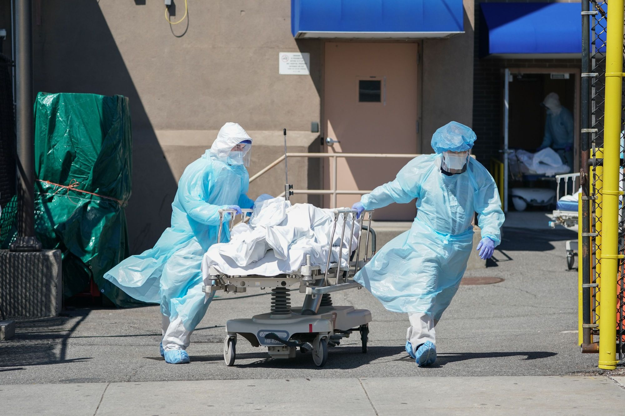 Bodies are moved to a refrigeration truck serving as a temporary morgue at Wyckoff Hospital in the Borough of Brooklyn on April 6, 2020 in New York. (BRYAN R. SMITH/AFP via Getty Images)