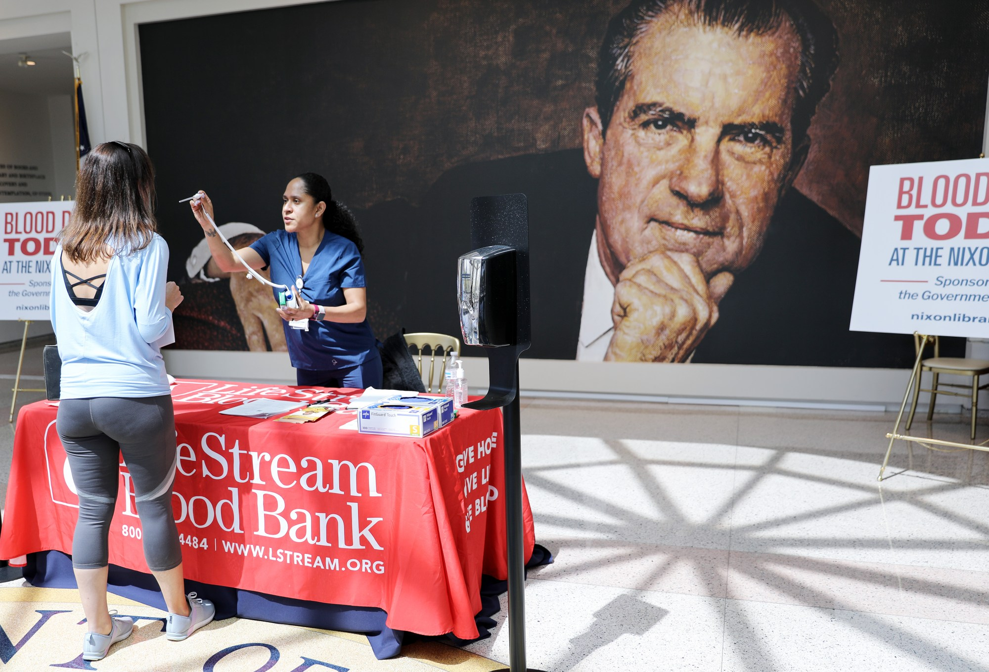 A nurse checks the temperature of a potential donor during a blood drive at the Richard Nixon Presidential Library in Yorba Linda on March 30, 2020. (Mario Tama/Getty Images)