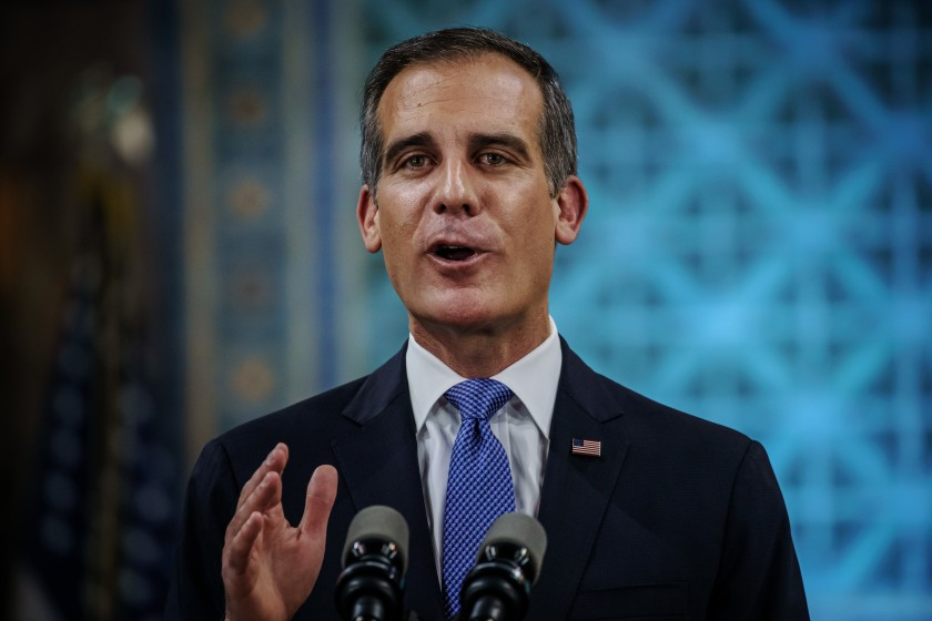 Mayor Eric Garcetti delivers his State of the City address Sunday night in a nearly empty City Council chamber on April 19, 2020. (Marcus Yam/Los Angeles Times)