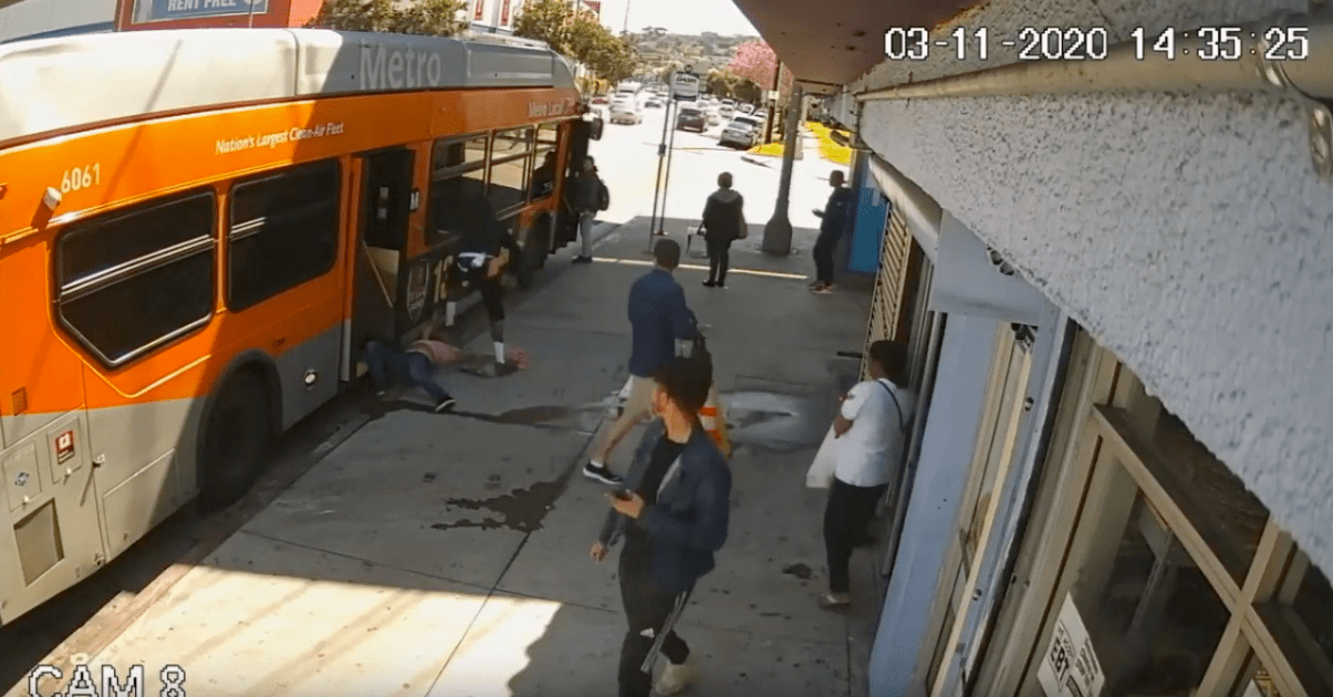 A man is seen attacking another man getting off a bus on March 11, 2020 in video released by the LAPD.