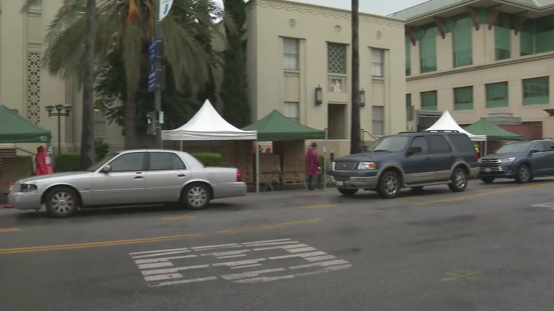 Vehicles line up ahead of a food pantry giveaway in Van Nuys on April 9, 2020. (KTLA)