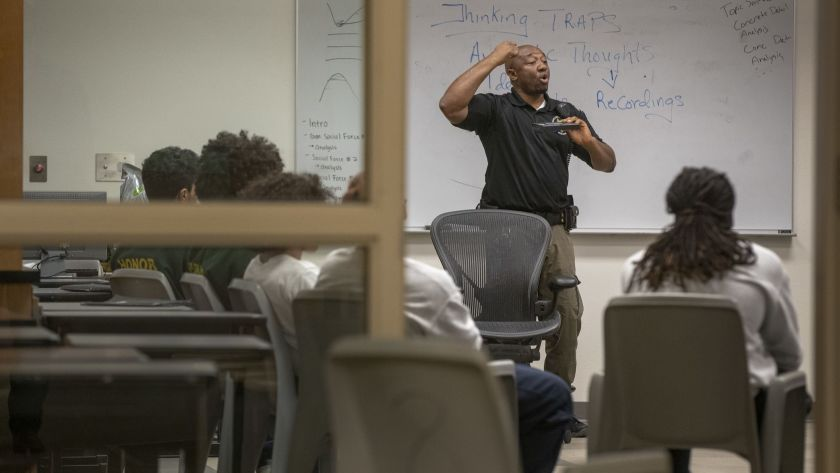 Probation officer William Agborsangaya conducts a leadership program at the Sacramento County Youth Detention Facility in January 2019. (Credit: Brian van der Brug / Los Angeles Times)