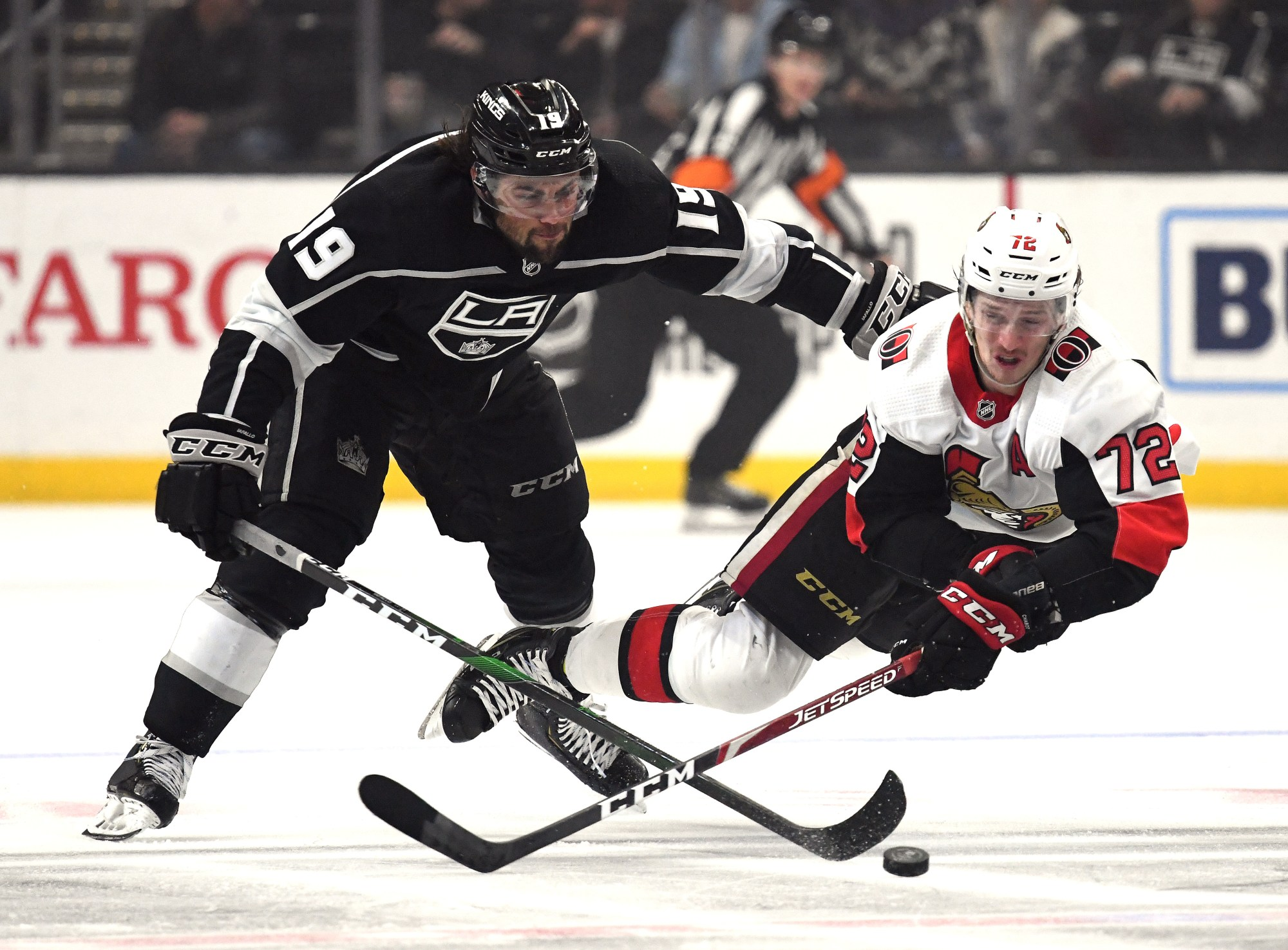 Thomas Chabot of the Ottawa Senators dives for a puck in front of Alex Iafallo of the Los Angeles Kings during the second period at Staples Center on March 11, 2020. (Harry How/Getty Images)