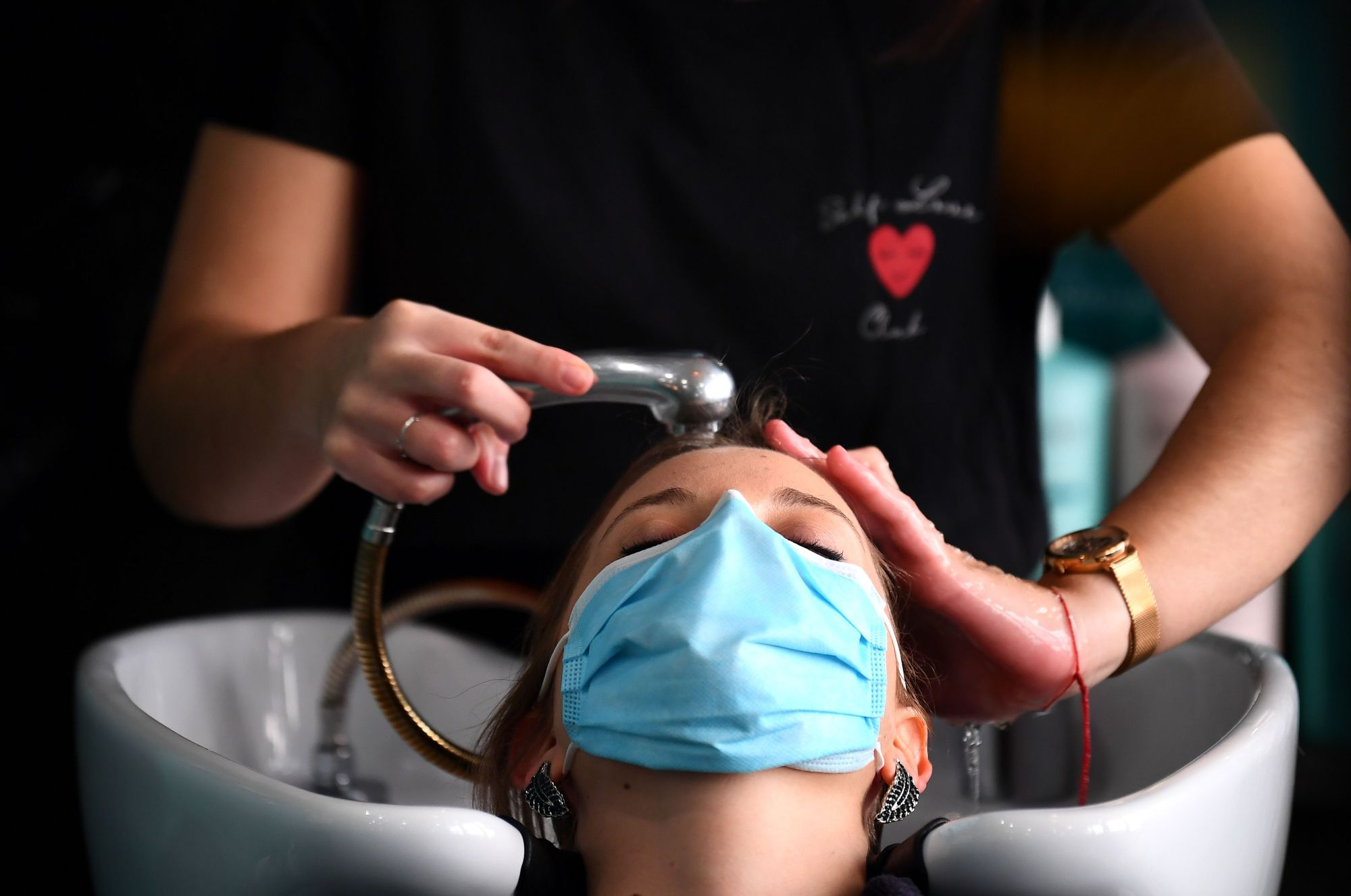 A nurse gets a haircut at a Paris salon where the first two days of work are dedicated to nursing staff on May 12, 2020, after France eased lockdown measures taken to curb the spread of COVID-19. (Franck Fife / AFP / Getty Images)