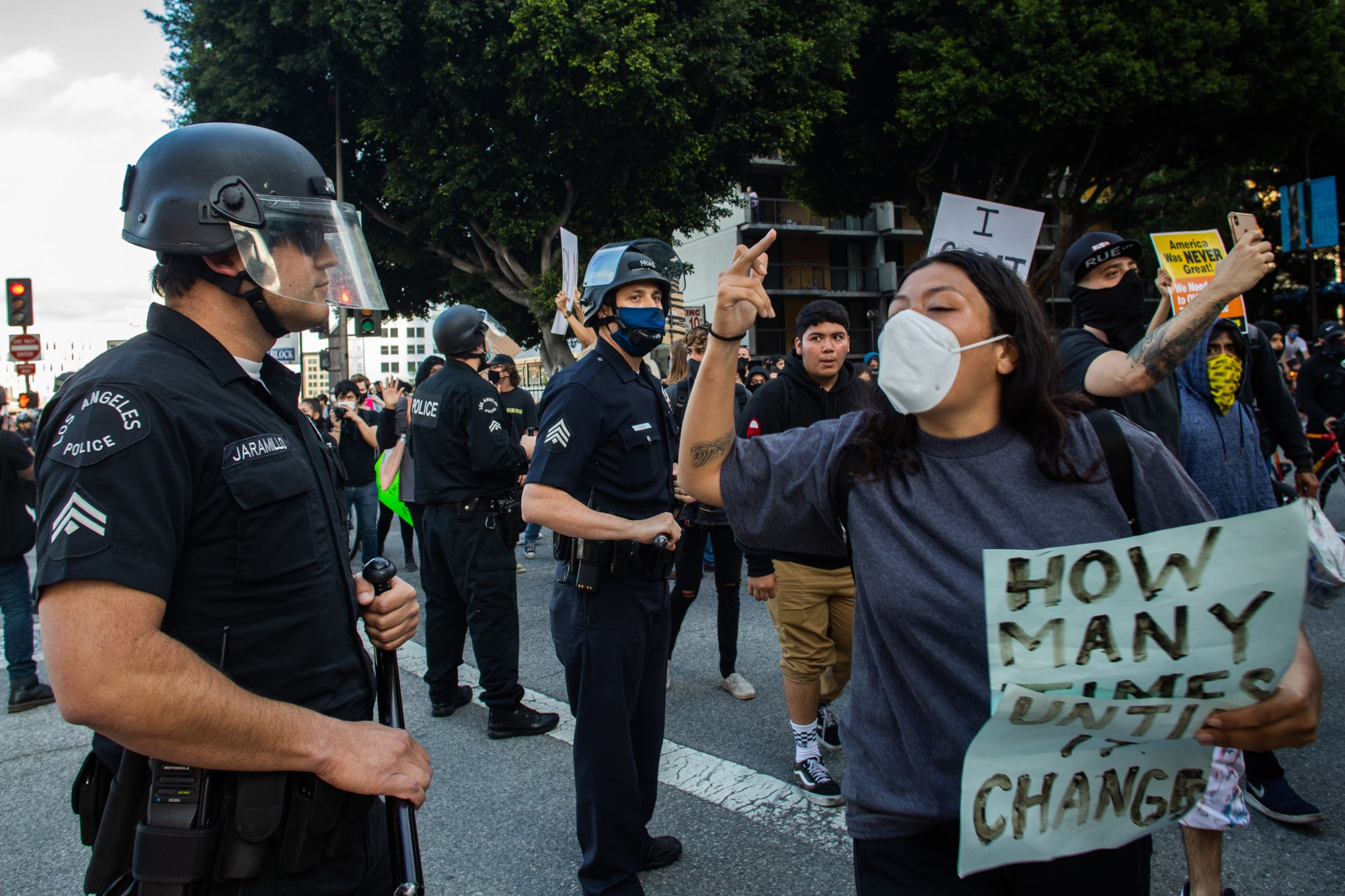 Demonstrators protest in response to the police killing of George Floyd on May 29, 2020, in Los Angeles, California. (Apu Gomes/Getty Images)