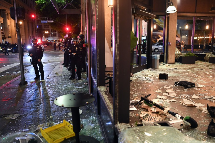 A Starbucks is looted along Spring Street in downtown Los Angeles on May 29, 2020. (Wally Skalij/Los Angeles Times)