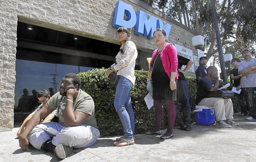 The California Department of Motor Vehicles may be able to reopen field offices this month, but new social distancing rules will prohibit the kind of crowding customarily seen in the offices.(Luis Sinco / Los Angeles Times)