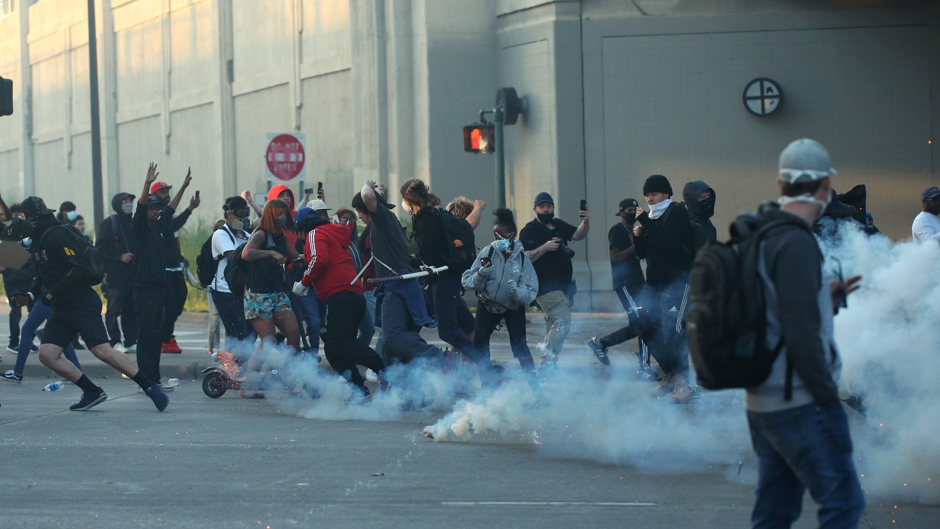 People run as tear gas canisters land near them during a protest sparked by the death of George Floyd while he was in police custody on May 29, 2020 in Minneapolis, Minnesota. (Scott Olson/Getty Images)