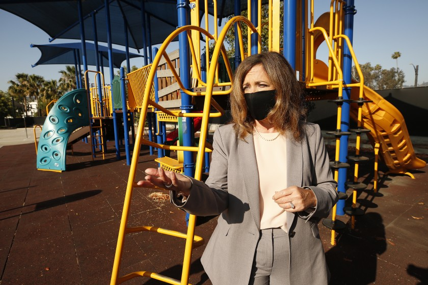 In this May 2020 photo, L.A. County Office of Education Superintendent Debra Duardo explains that a play structure at Cerritos Elementary in Glendale would be off-limits to students under current health directives when the school reopens. (Al Seib / Los Angeles Times)
