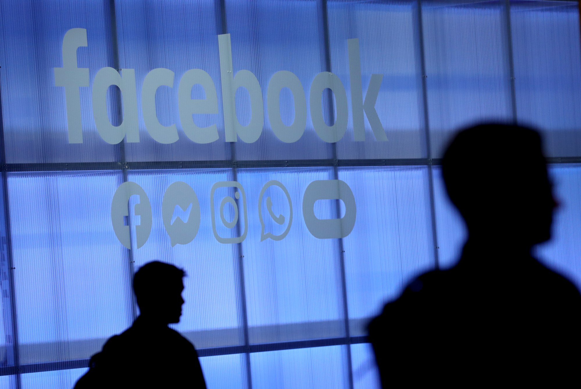 The Facebook logo is displayed during the F8 Facebook Developers conference on April 30, 2019 in San Jose. (Credit:Justin Sullivan/Getty Images)