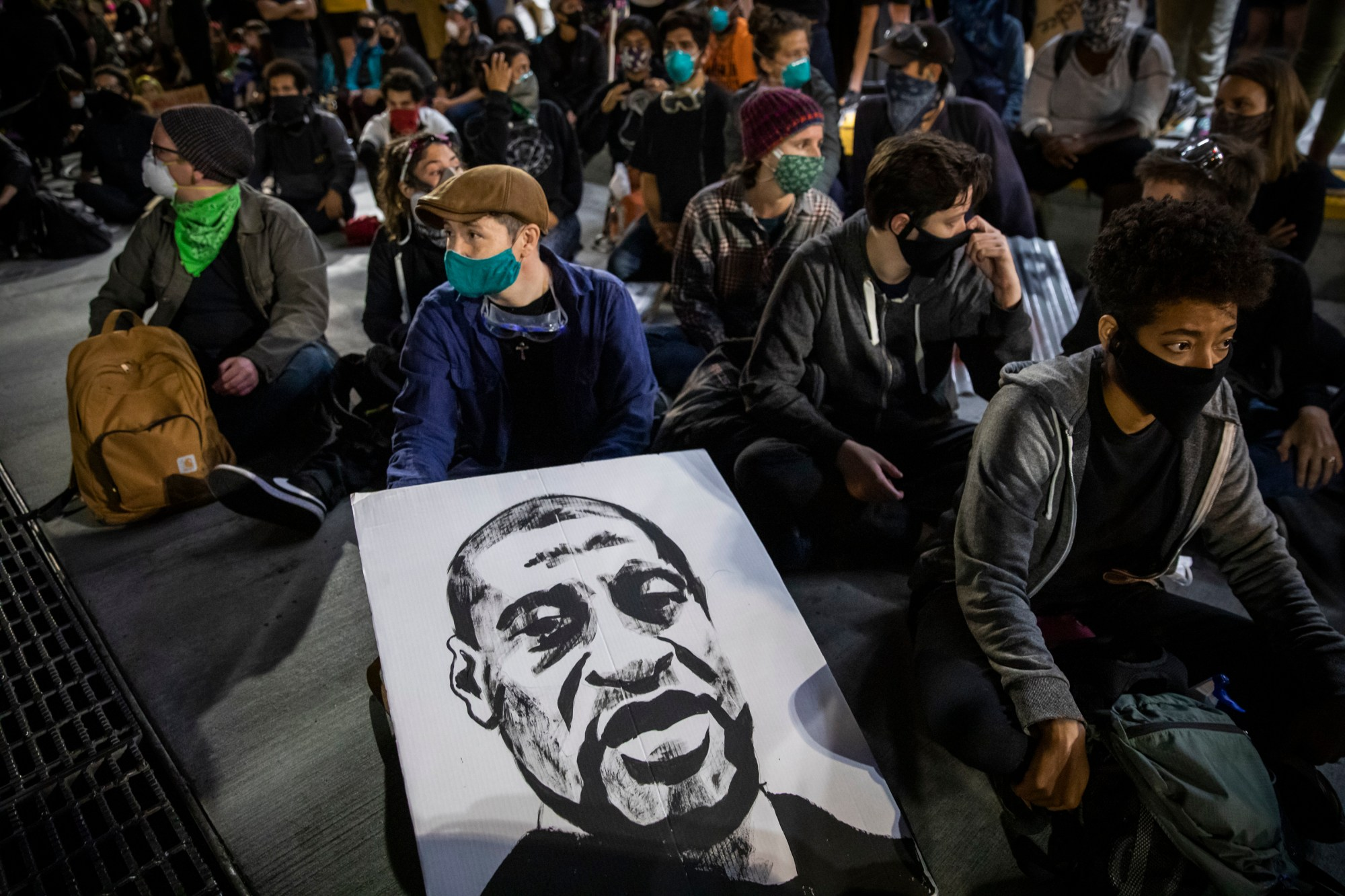 "Demonstrators attend a ""Sit Out the Curfew"" protest against the death of George Floyd who died on May 25 in Minneapolis whilst in police custody, along a street in Oakland, California on June 3, 2020. (PHILIP PACHECO/AFP via Getty Images)"