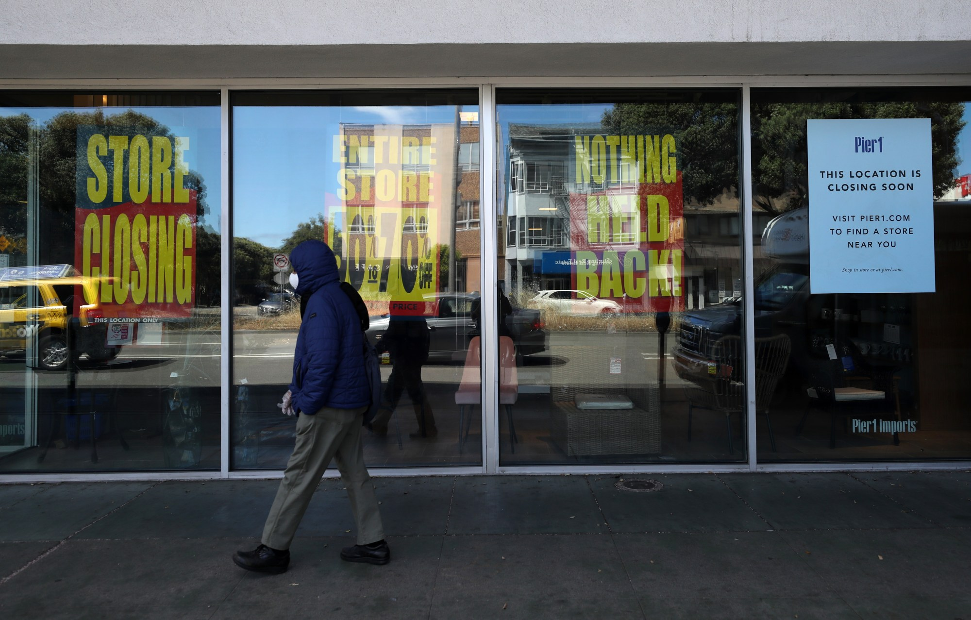 A pedestrian walks by a closed Pier 1 store on May 19, 2020 in San Francisco, California. (Justin Sullivan/Getty Images)
