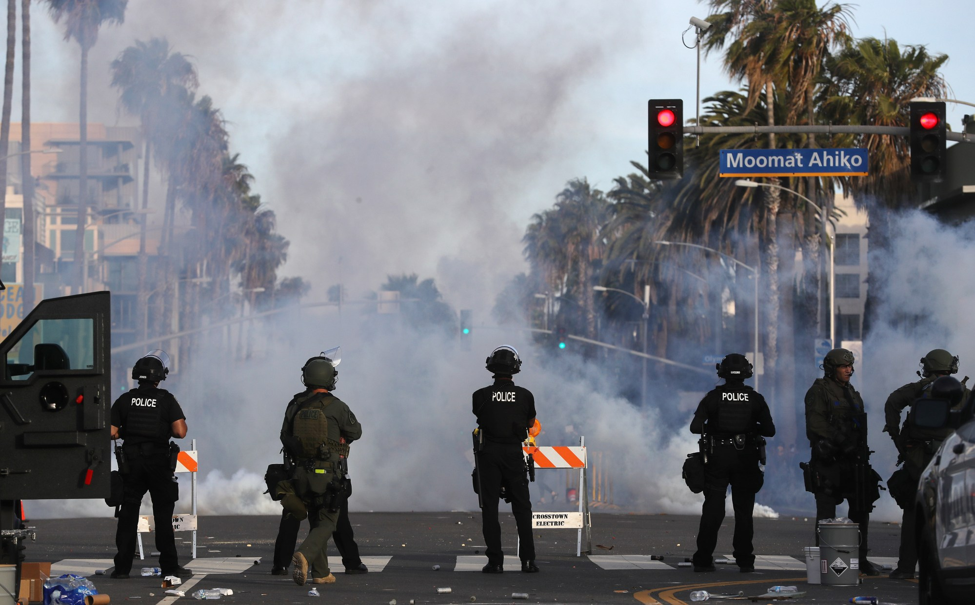 Police watch as tear gas is deployed during demonstrations in Santa Monica following the death of George Floyd on May 31, 2020.(Mario Tama/Getty Images)