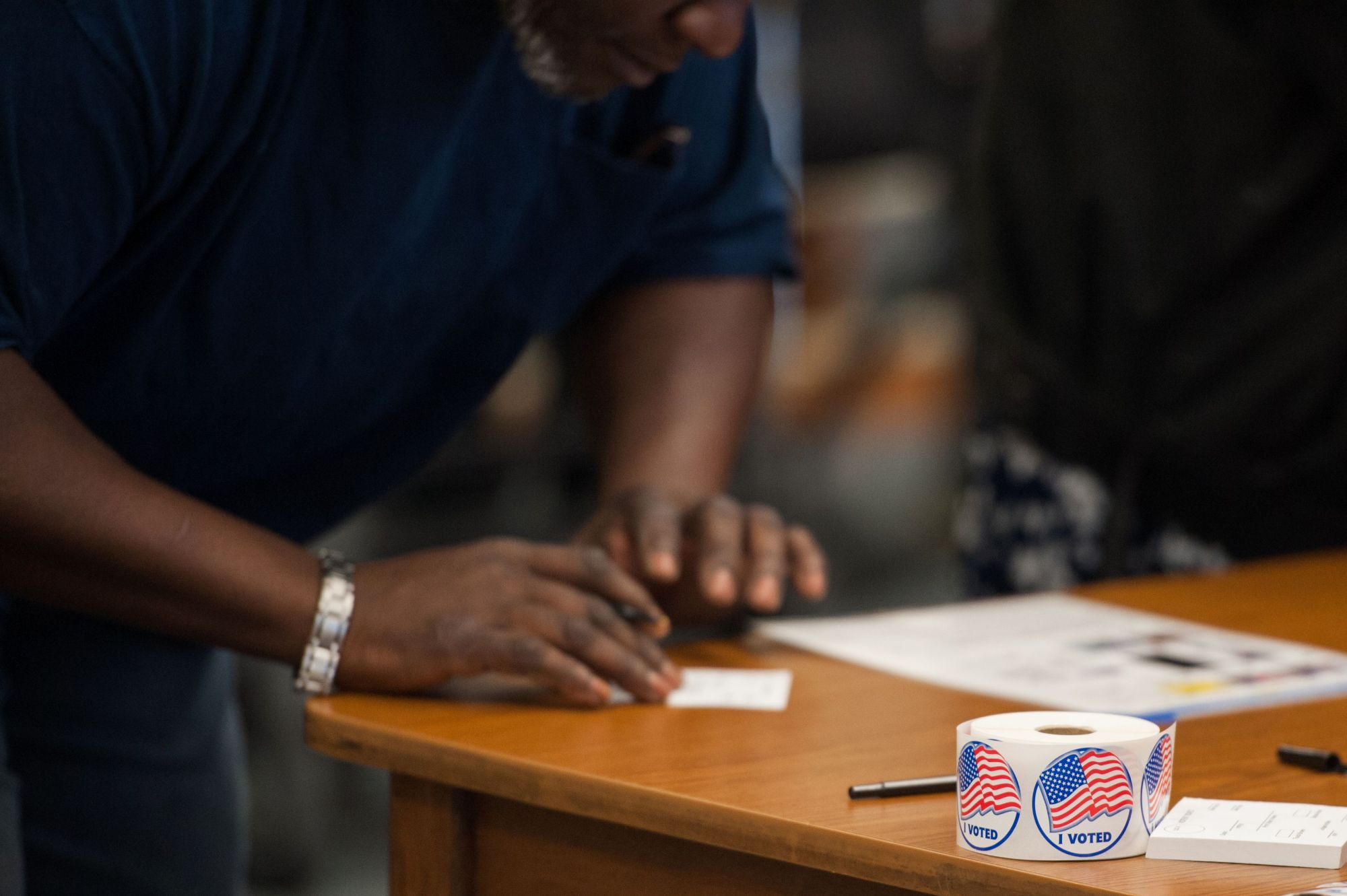 Voting stickers are seen as a man is checked in to receive his ballot during Missouri primary voting on March 15, 2016, in Ferguson, Missouri. (MICHAEL B. THOMAS/AFP via Getty Images)