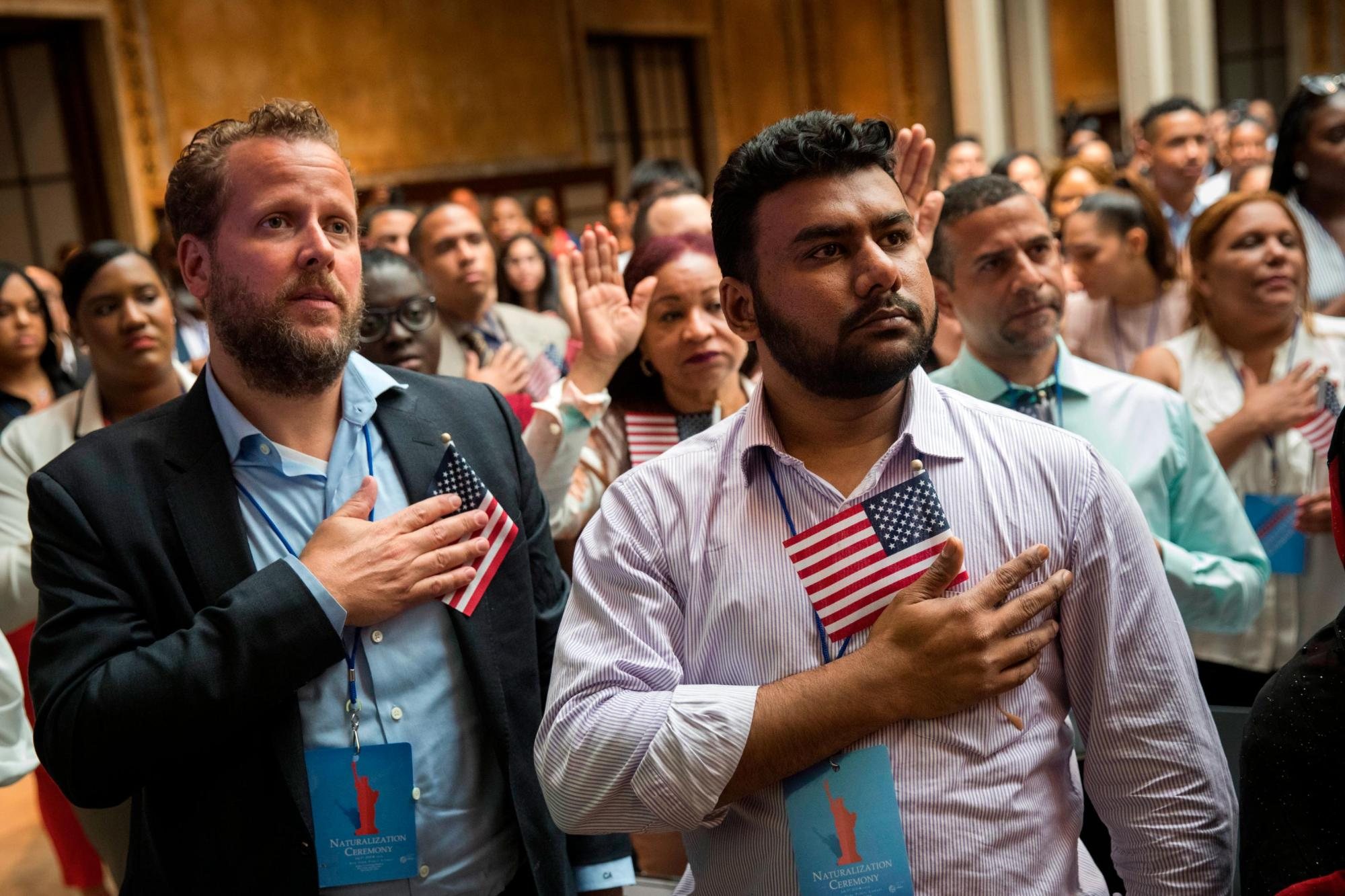 New U.S. citizens recite the Pledge of Allegiance during a naturalization ceremony in New York in 2018. (Drew Angerer/Getty Images)