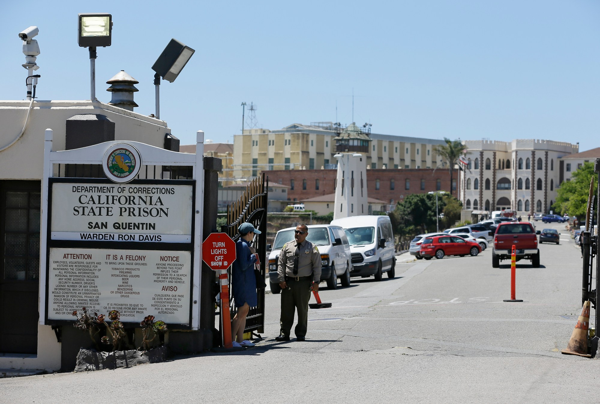 A Department of Corrections officer guards the main entryway leading into San Quentin State Prison on July 24, 2019. (AP Photo/Eric Risberg, File)