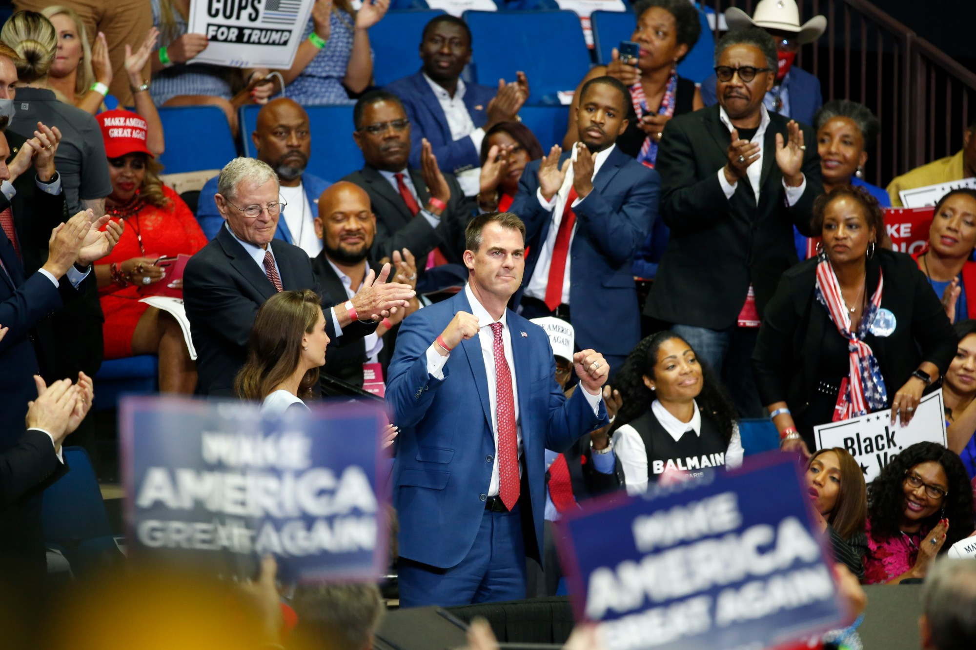 In this June 20, 2020 photo, Oklahoma Gov. Kevin Stitt is recognized as President Donald Trump speaks during a campaign rally at the BOK Center, in Tulsa, Okla. (AP Photo/Sue Ogrocki, File)