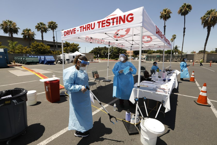 At the Anaheim Convention Center, medical staff administer COVID-19 test kits on July 15, 2020. (Carolyn Cole / Los Angeles Times)