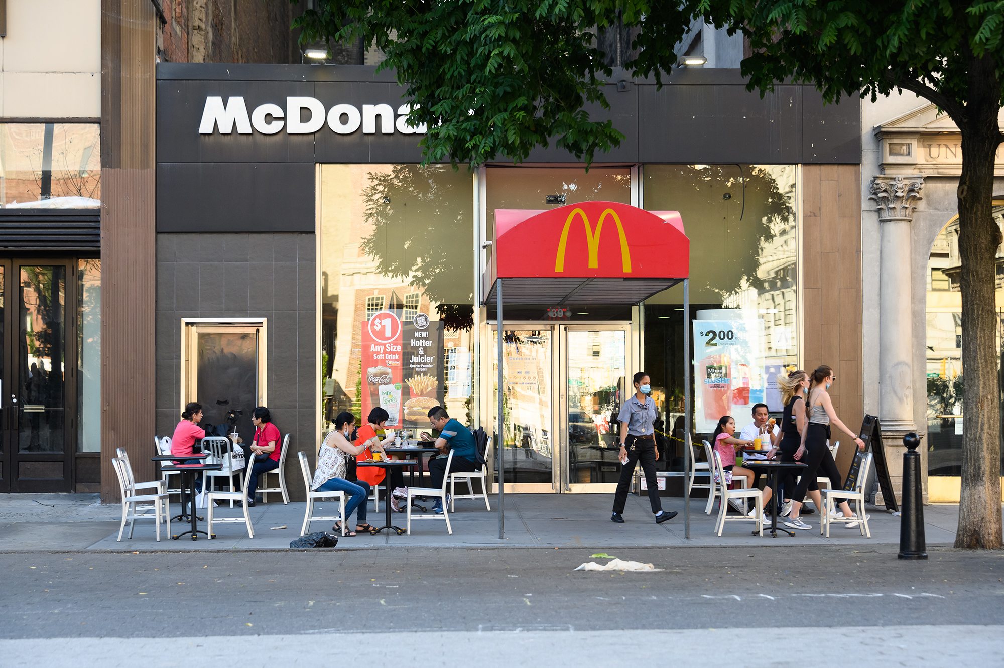 Customers dine outside McDonald's in Union Square as New York City moves into Phase 2 of re-opening following restrictions imposed to curb the coronavirus pandemic on June 24, 2020. (Noam Galai/Getty Images)