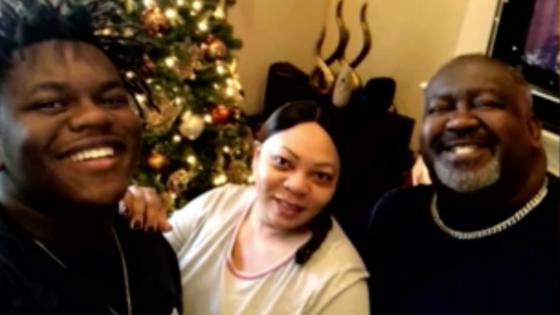 Justin Hunter, Angie Hunter and Eugene Hunter Jr. are seen in a family photo.